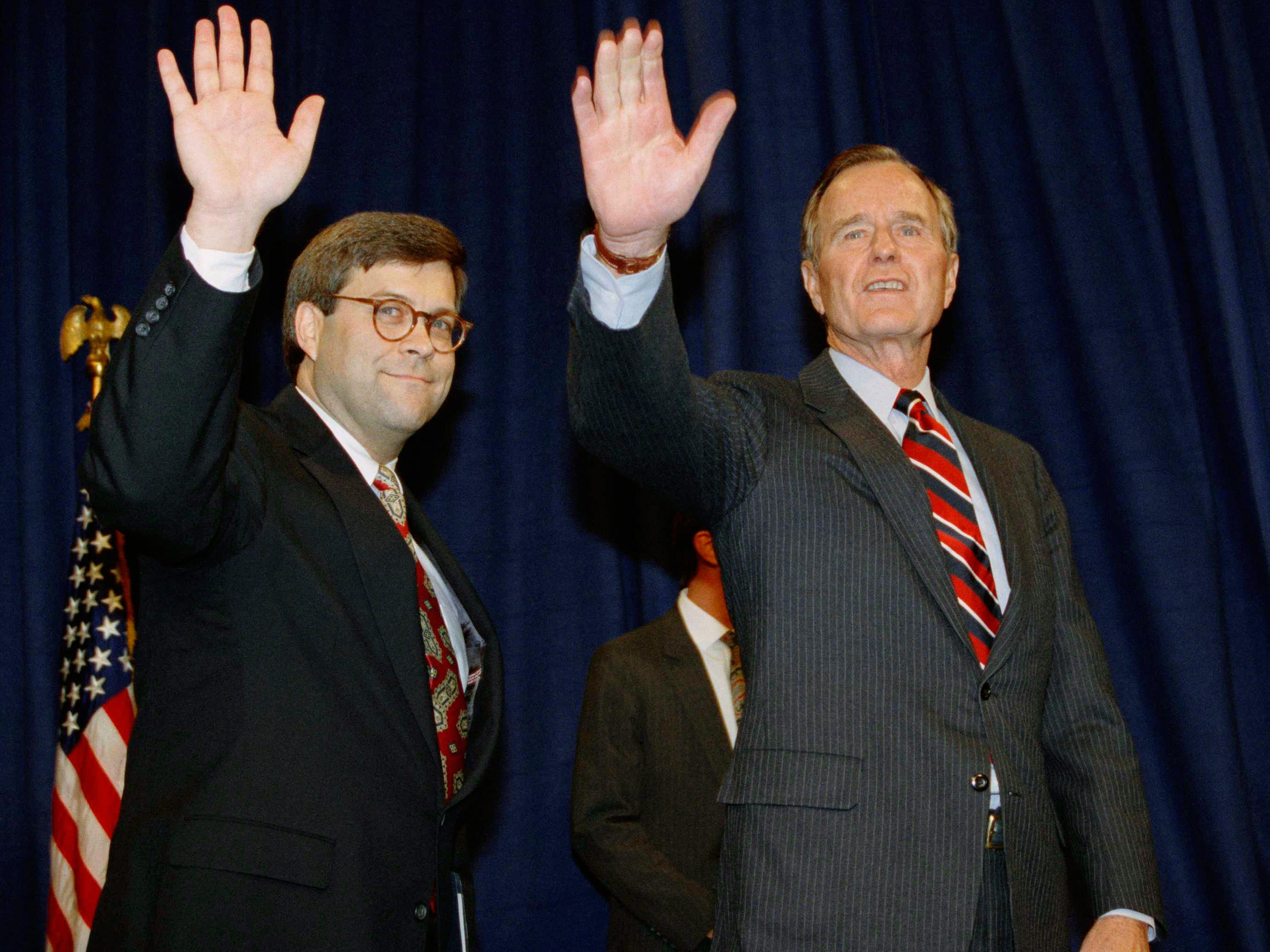 FILE - In this Nov. 26, 1991, file photo, President George H.W Bush, right, and William Barr wave after Barr was sworn in as the new Attorney General of the United States at a Justice Department ceremony in Washington. Barr, who served as attorney general under Bush, has emerged as a top contender for that job in President Donald Trump's Cabinet, two people familiar with the president's selection process said Thursday, Dec. 6, 2018. (AP Photo/Scott Applewhite, File) ORG XMIT: NYHK405