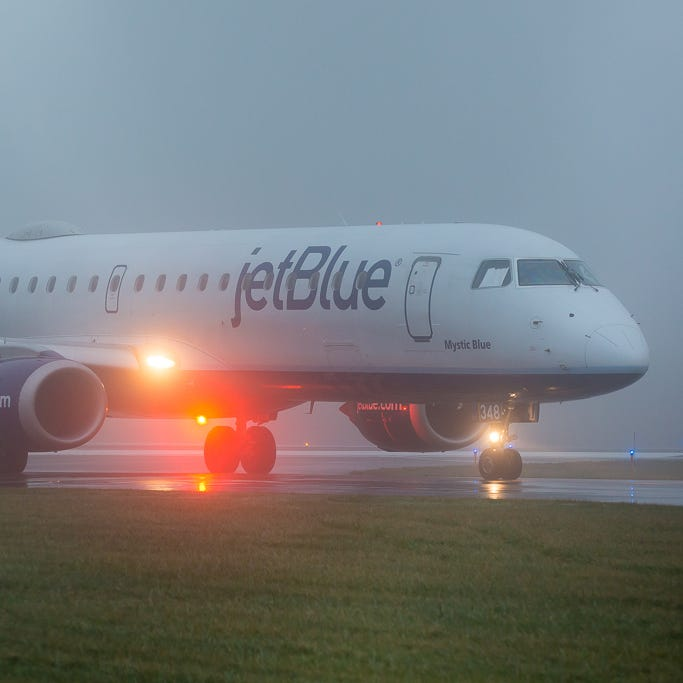 A jetBlue Embraer E190 taxies to the gate at Worcester Airport in central Massachusetts after a short flight up from Florida in December, 2018.