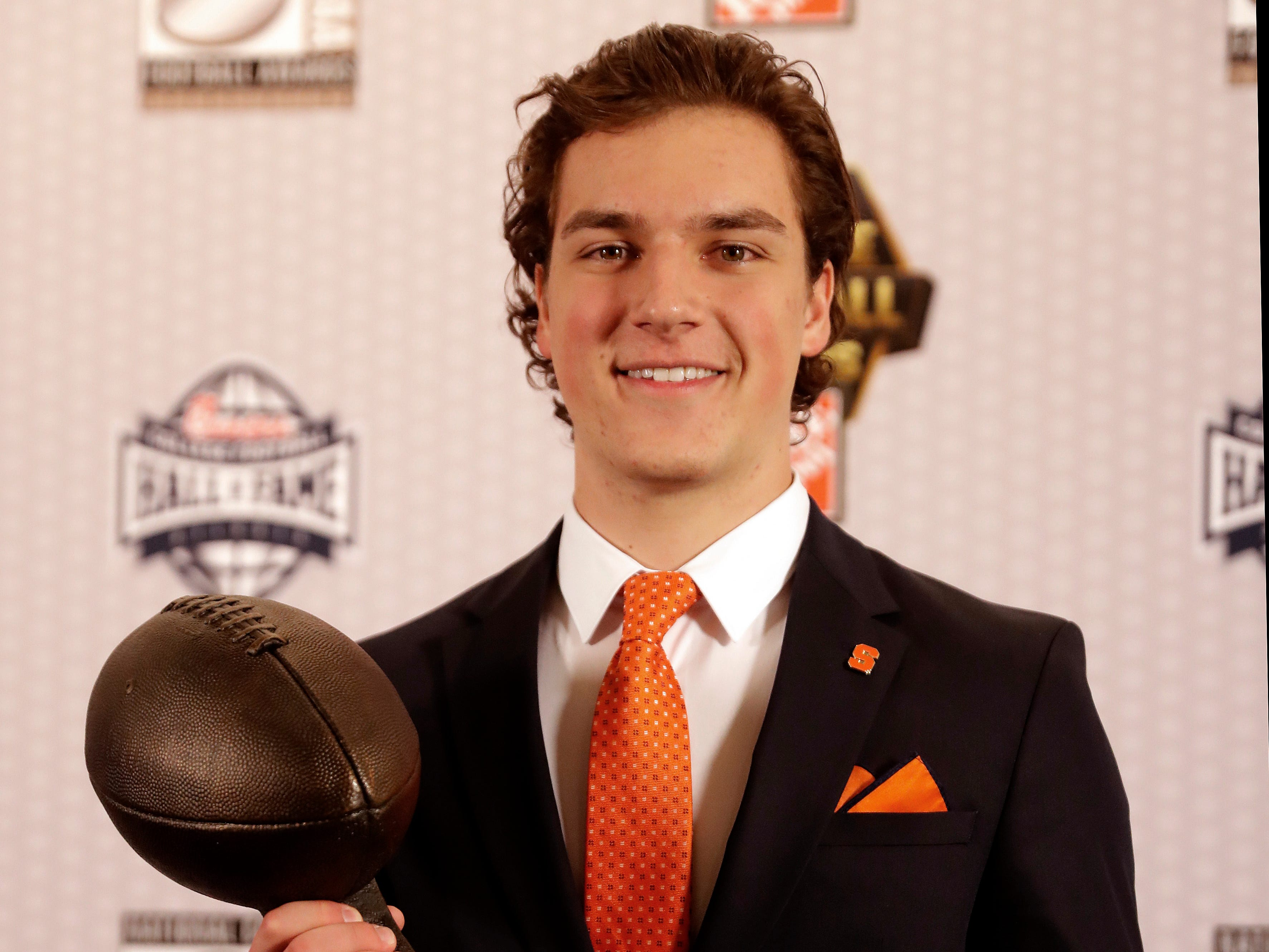 Syracuse's Andre Szmyt poses with the trophy after winning The Lou Groza  Award for being the best kicker in college football.