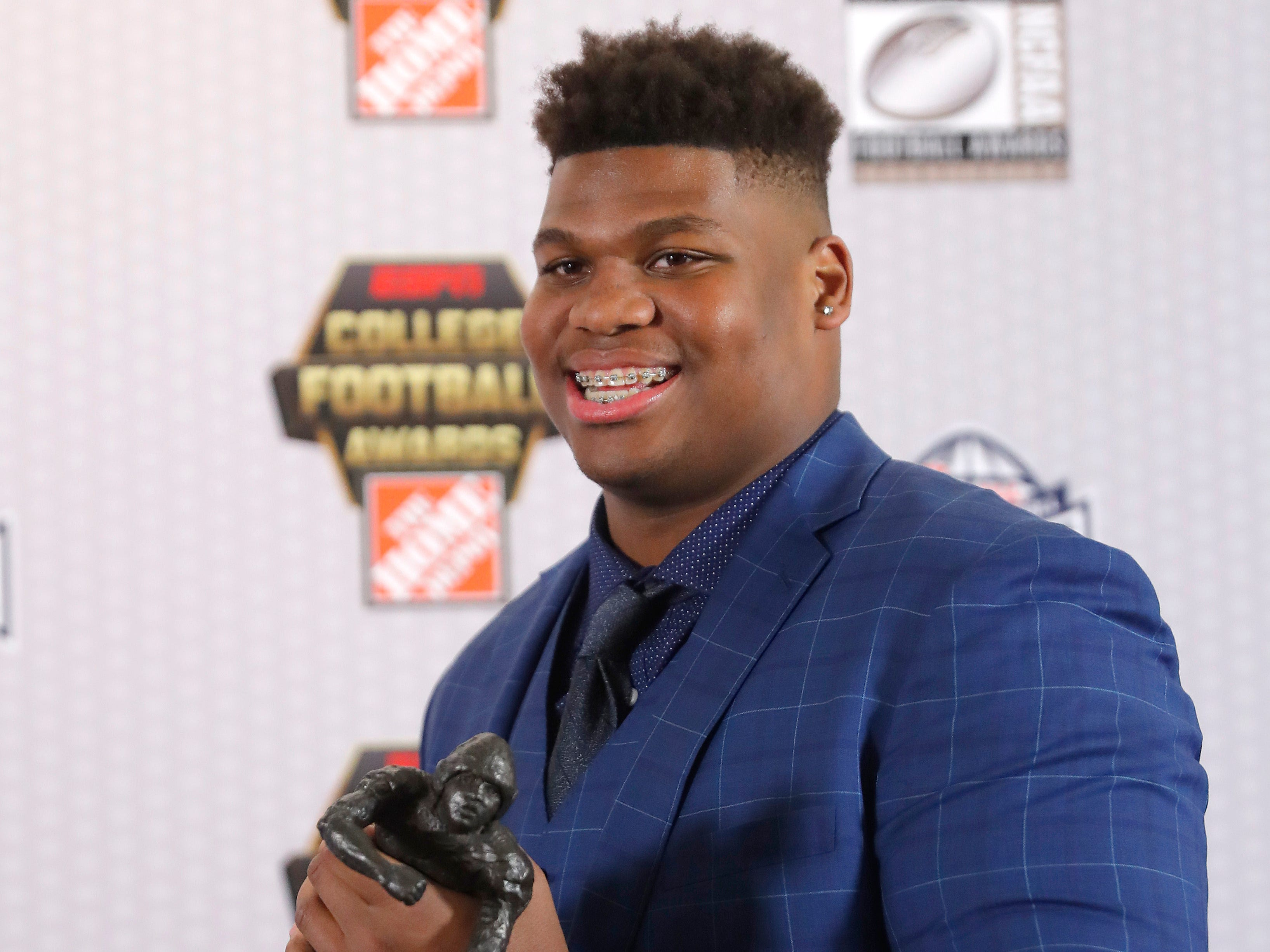 Alabama's Quinnen Williams poses with the trophy after winning the Outland Trophy as the nation's best interior lineman in college football.