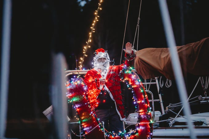 Ron Santa lights up as Santa .The Western Carolina Sailing Club held their Cruising Fleet Annual Parade of Lights on Lake Hartwell in Anderson Friday, December 7, 2018.