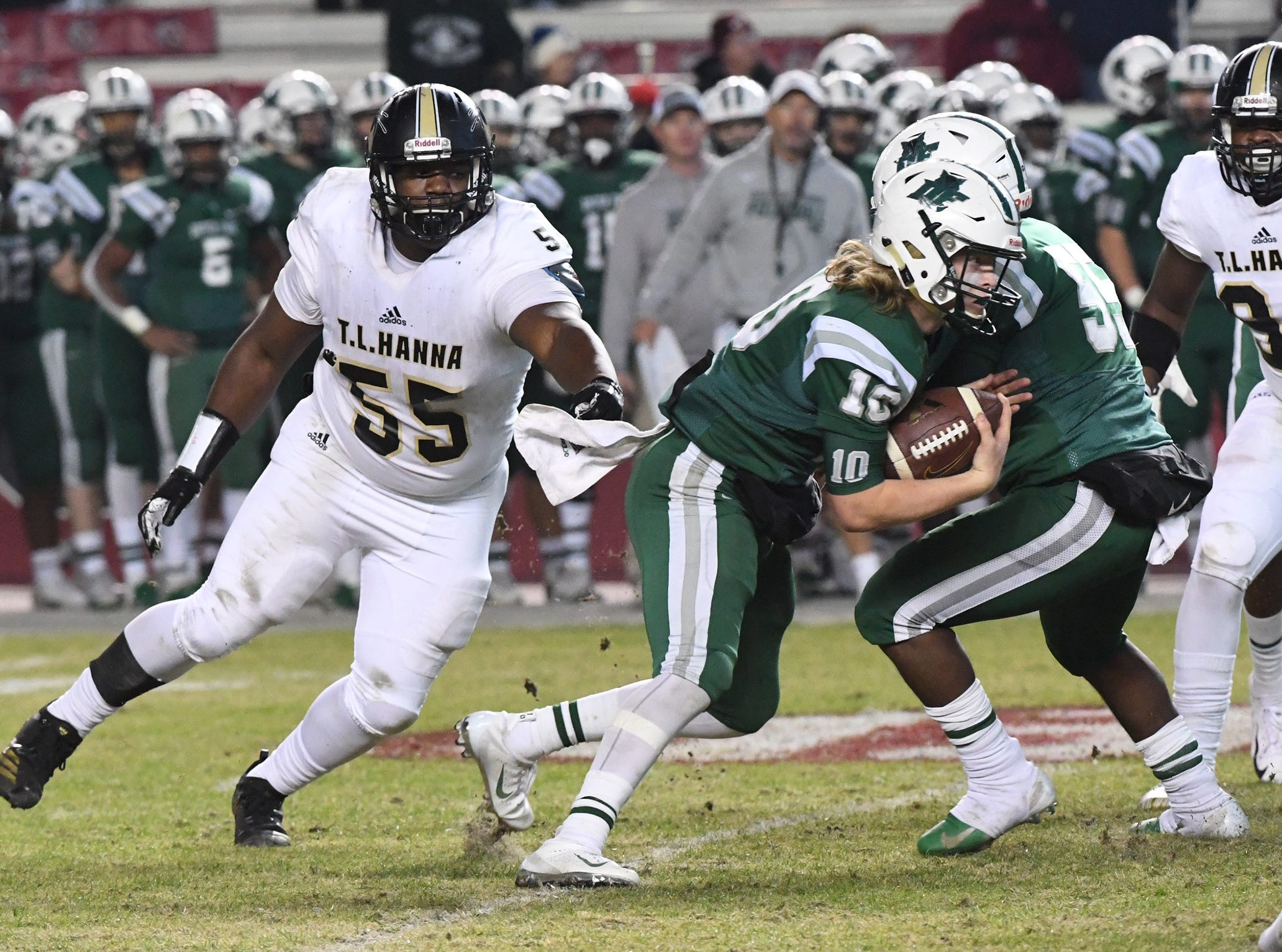 TL Hanna senior Devonte Jones (55) pursues Dutch Fork junior Tyler Olenchuk(10) during the fourth quarter of the Class AAAAA state championship game at Williams-Brice Stadium in Columbia Saturday, December 8, 2018.
