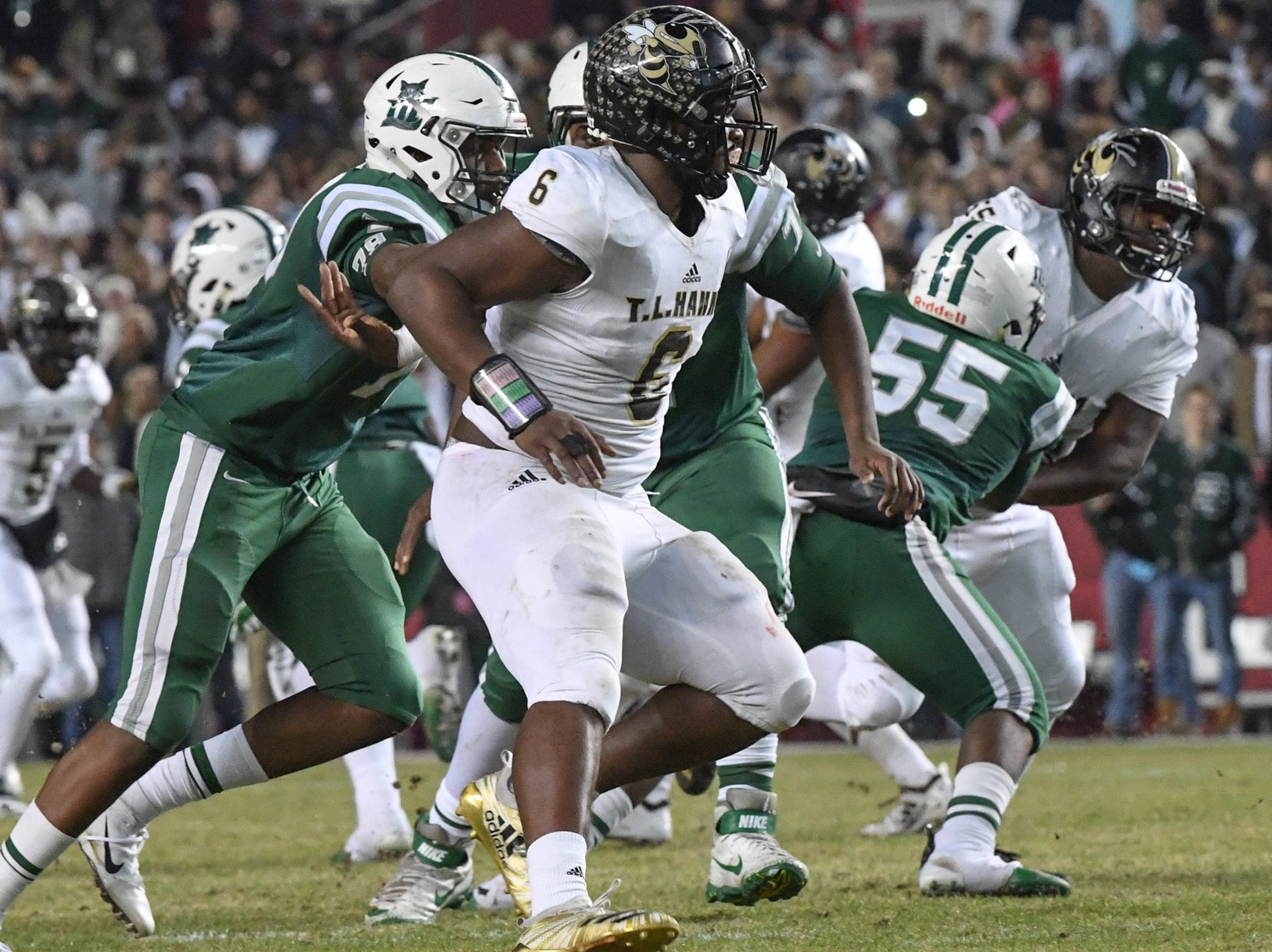 TL Hanna senior Zacch Pickens (6) pressures Dutch Fork junior Tyler Olenchuk(10) during the first quarter of the Class AAAAA state championship game at Williams-Brice Stadium in Columbia Saturday, December 8, 2018.