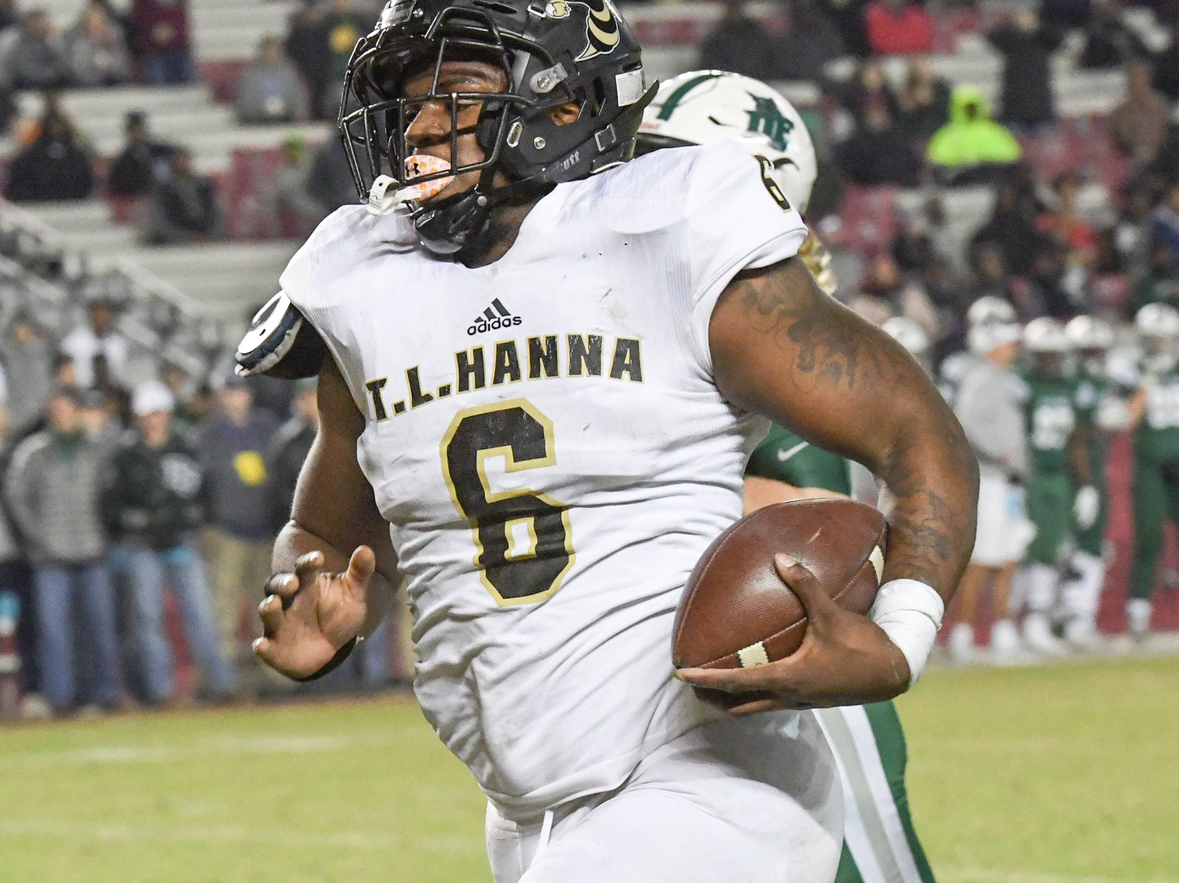 TL Hanna senior Zacch Pickens (6) returns an interception for a touchdown against Dutch Fork High School during the first quarter of the Class AAAAA state championship game at Williams-Brice Stadium in Columbia Saturday, December 8, 2018.