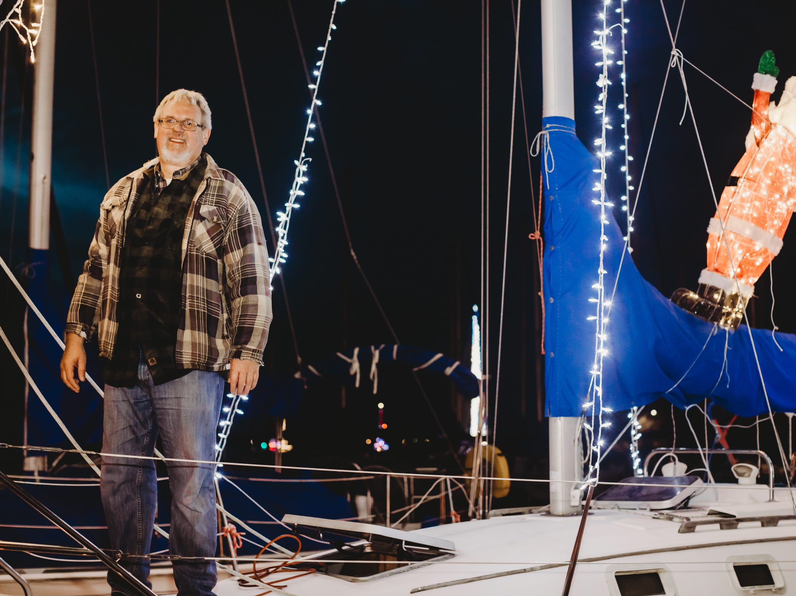 Werner Lehmann on deck .The Western Carolina Sailing Club held their Cruising Fleet Annual Parade of Lights on Lake Hartwell in Anderson Friday, December 7, 2018.