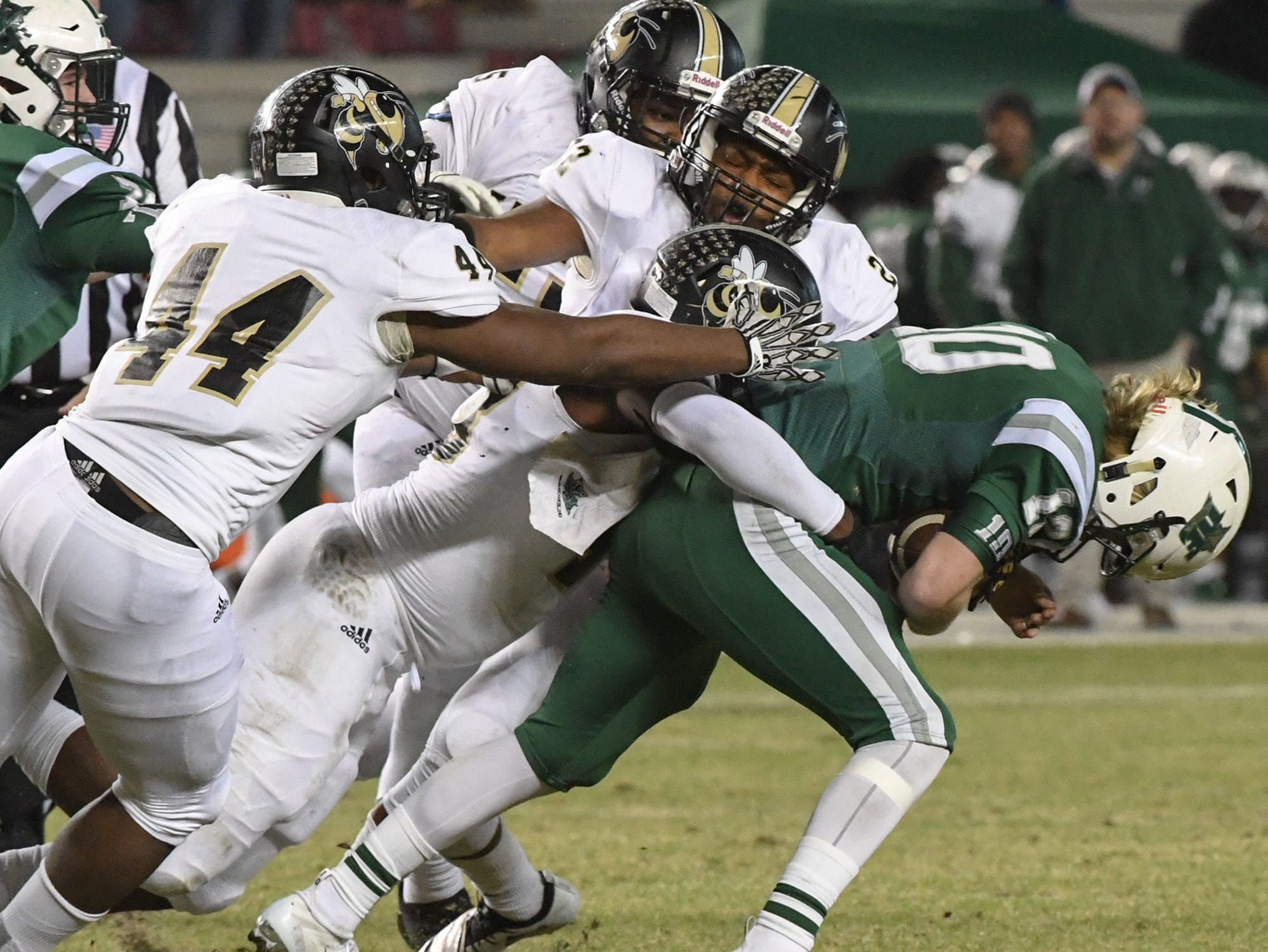 TL Hanna junior Jaylin Thomas (43), TL Hanna junior Cameron Chandler (44) and TL Hanna senior Jaydon McKinney (22) tackle Dutch Fork junior Tyler Olenchuk(10) during the first quarter of the Class AAAAA state championship game at Williams-Brice Stadium in Columbia Saturday, December 8, 2018.