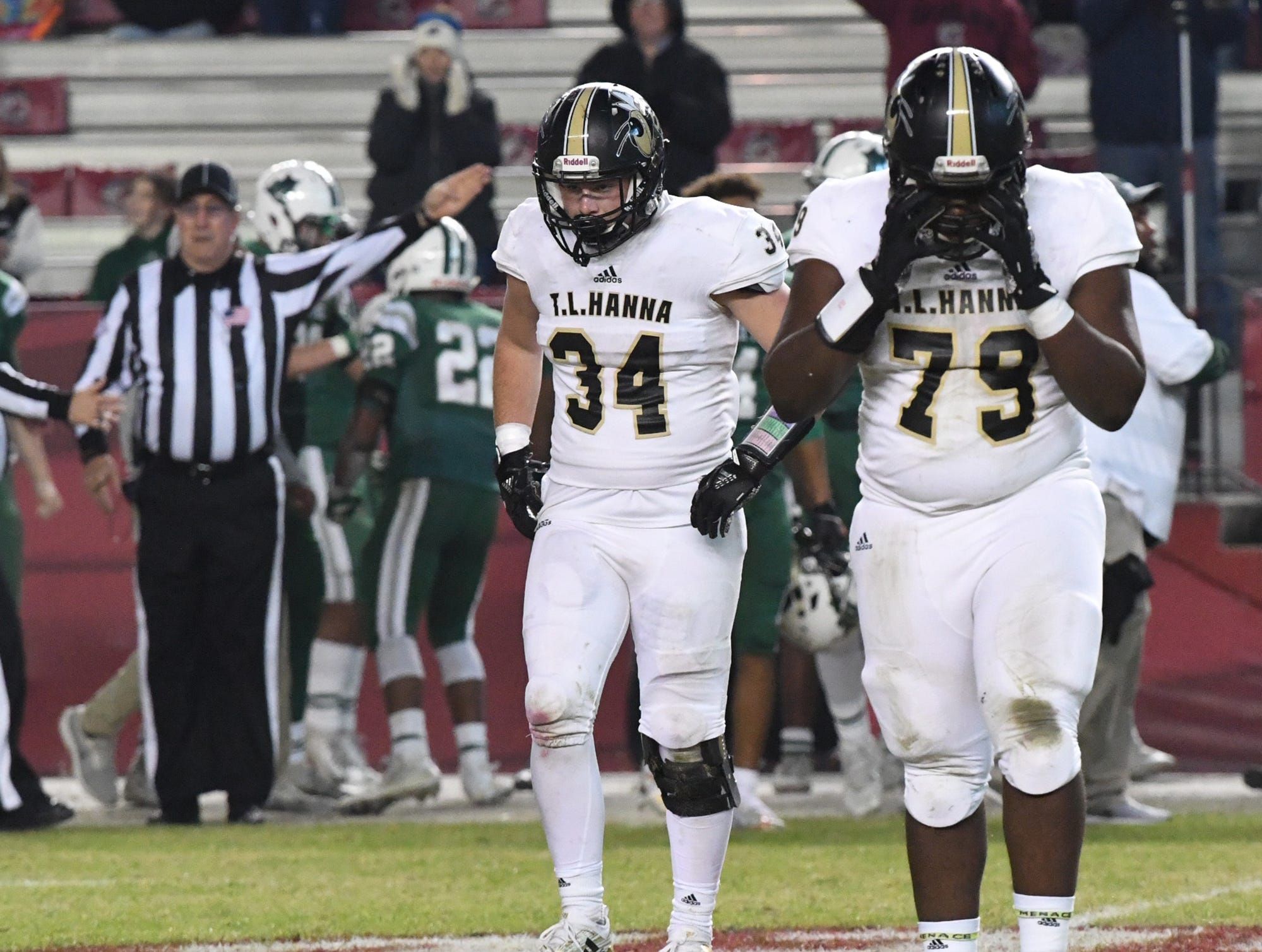 TL Hanna senior Winter Barrett (34) andTL Hanna sophomore Jahari Couser (79) react after a teammate fumbled during the fourth quarter of the Class AAAAA state championship game at Williams-Brice Stadium in Columbia Saturday, December 8, 2018.
