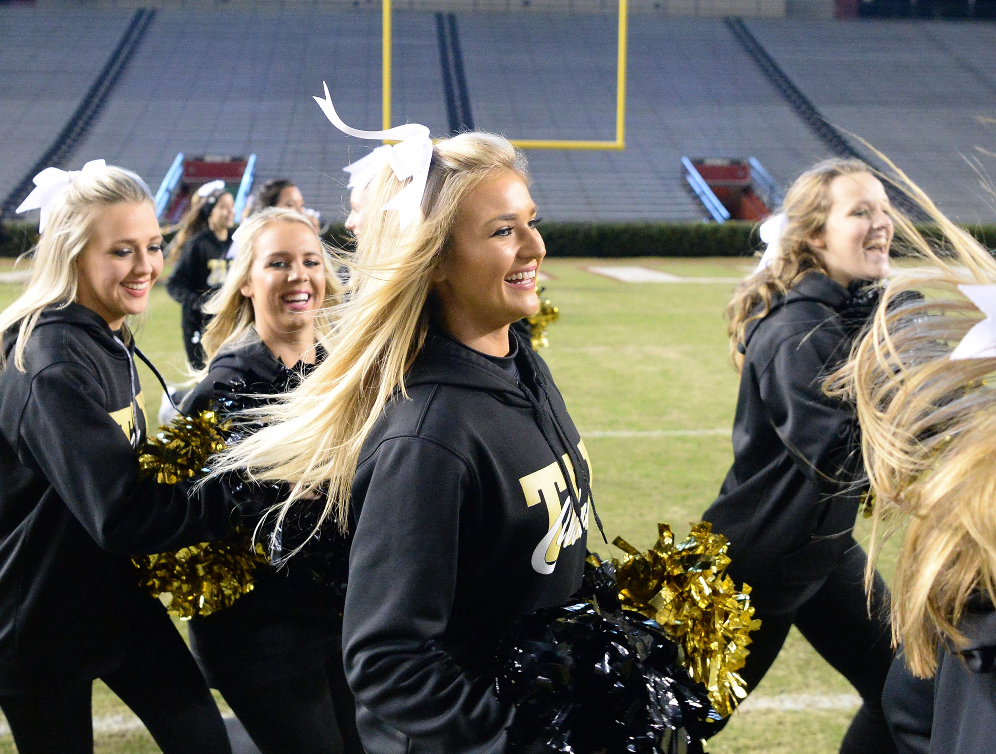 TL Hanna cheerleaders run after the team breaks through the banner before the kickoff of the Class AAAAA state championship game at Williams-Brice Stadium in Columbia Saturday, December 8, 2018.