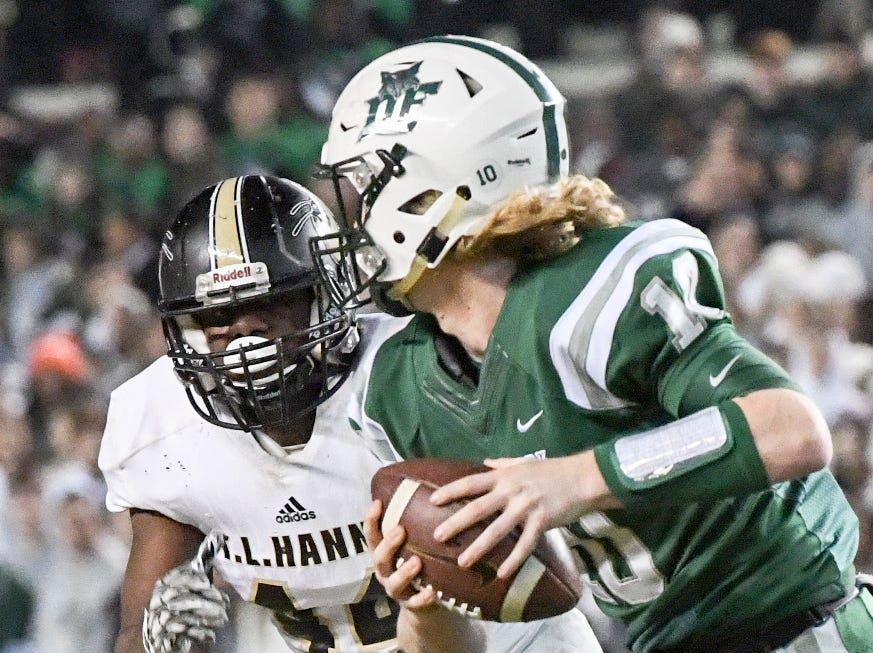 TL Hanna junior Cameron Chandler (44) chases Dutch Fork junior Tyler Olenchuk(10) during the second quarter of the Class AAAAA state championship game at Williams-Brice Stadium in Columbia Saturday, December 8, 2018.
