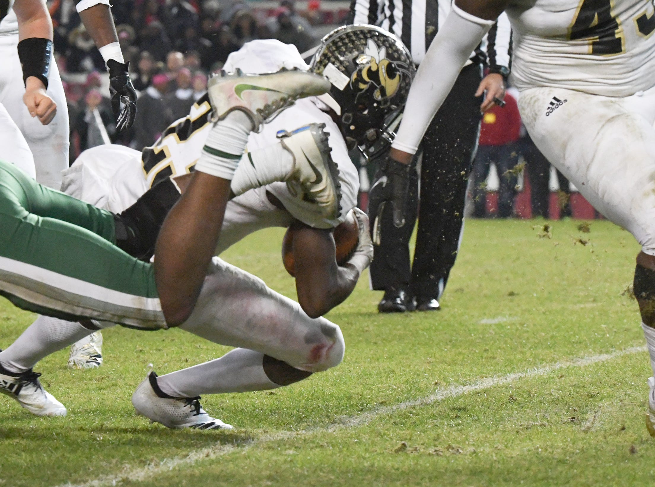 TL Hanna senior Isaiah Norris (23) scores an eight-yard touchdown against Dutch Fork during the second quarter of the Class AAAAA state championship game at Williams-Brice Stadium in Columbia Saturday, December 8, 2018.