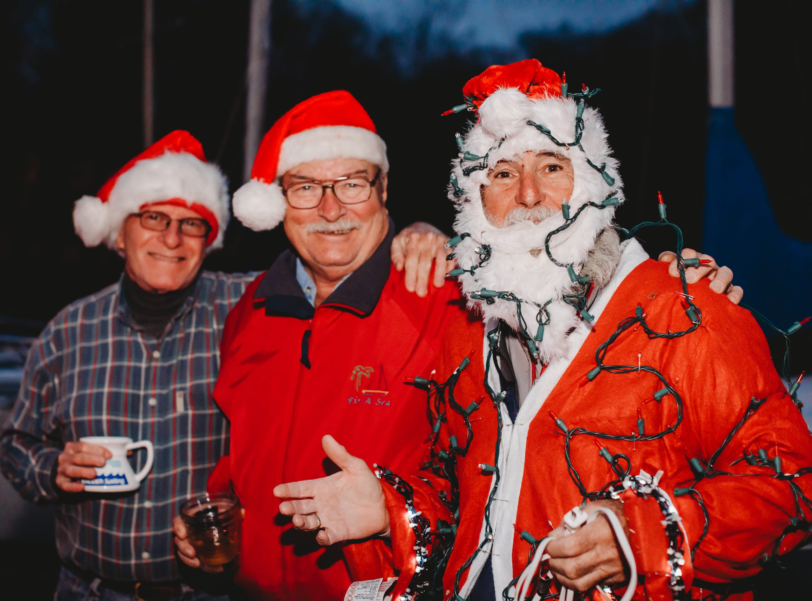 DJ Johnson, Van Vantleven, and Ron Sanga show off their Santa hats before the launch The Western Carolina Sailing Club held their Cruising Fleet Annual Parade of Lights on Lake Hartwell in Anderson Friday, December 7, 2018.