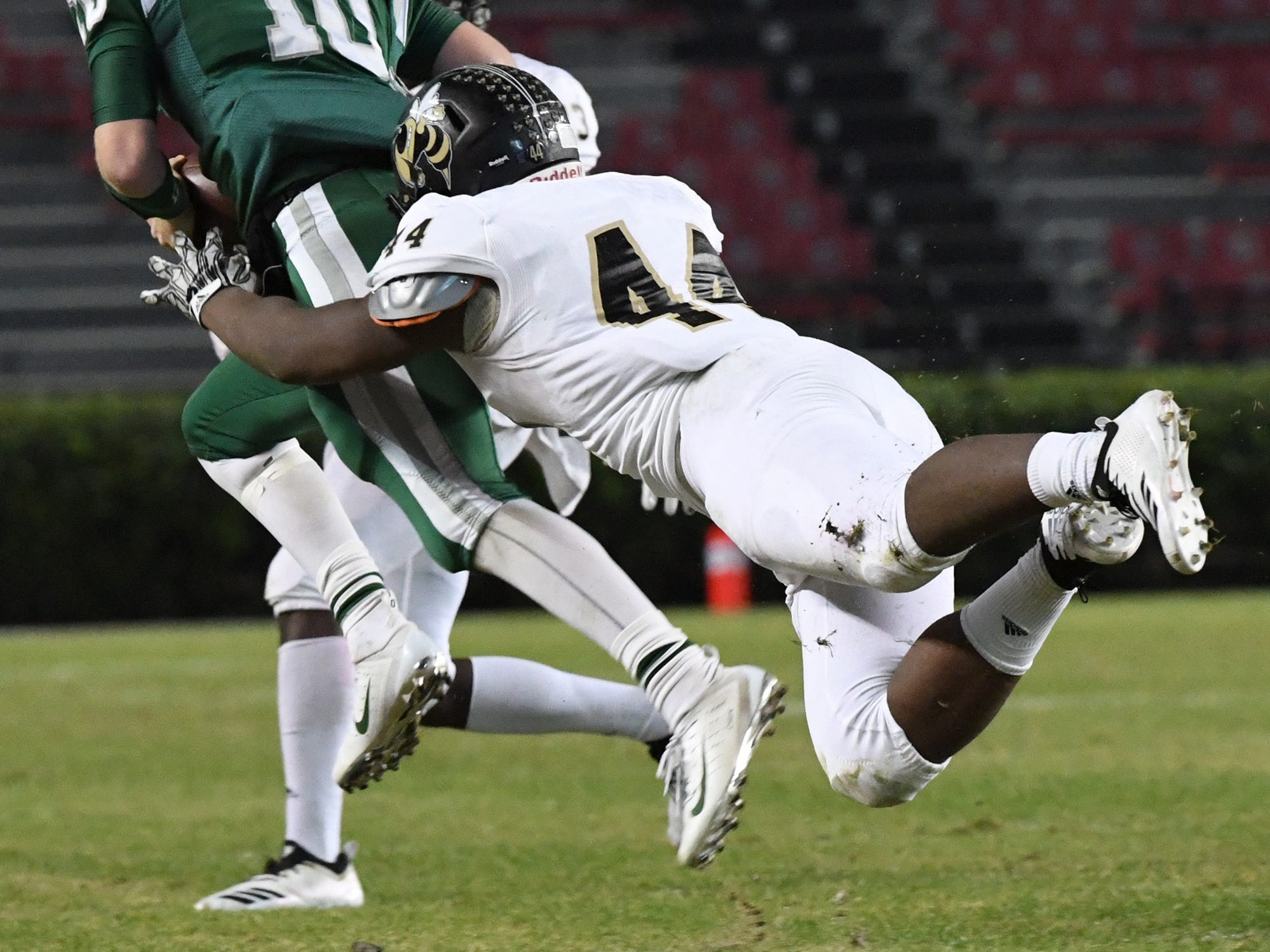 TL Hanna junior Cameron Chandler (44) dives to tackle Dutch Fork junior Tyler Olenchuk(10) during the third quarter of the Class AAAAA state championship game at Williams-Brice Stadium in Columbia Saturday, December 8, 2018.