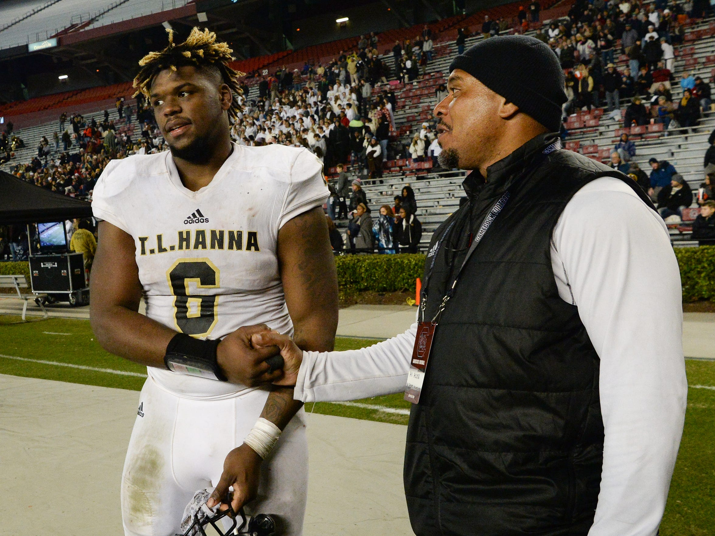 TL Hanna senior Zacch Pickens (6) and former Hanna quarterback Ramon Robinson after the game of the Class AAAAA state championship game at Williams-Brice Stadium in Columbia Saturday, December 8, 2018.