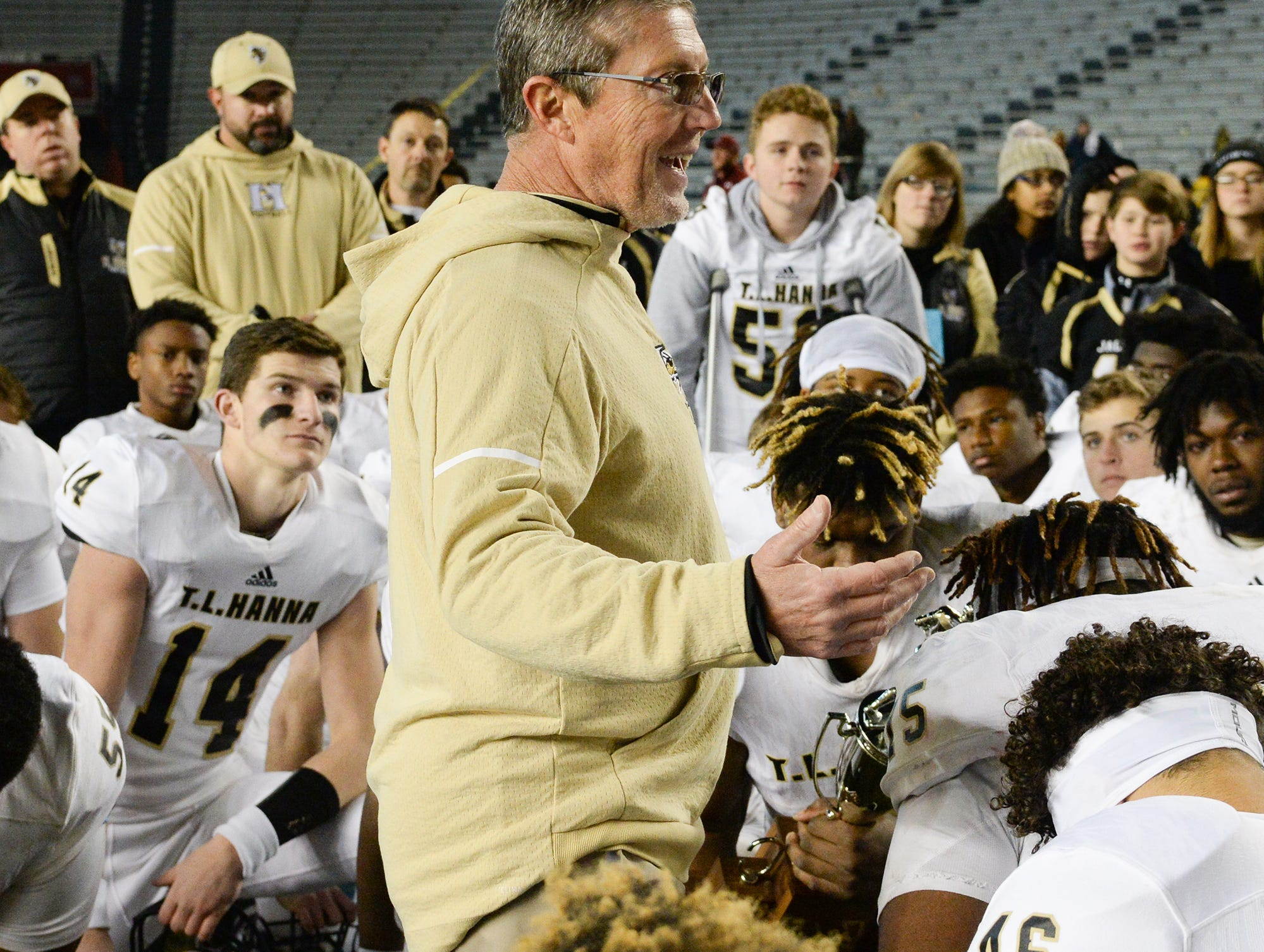 TL Hanna head coach Jeff Herron talks with player after the game of the Class AAAAA state championship game at Williams-Brice Stadium in Columbia Saturday, December 8, 2018.