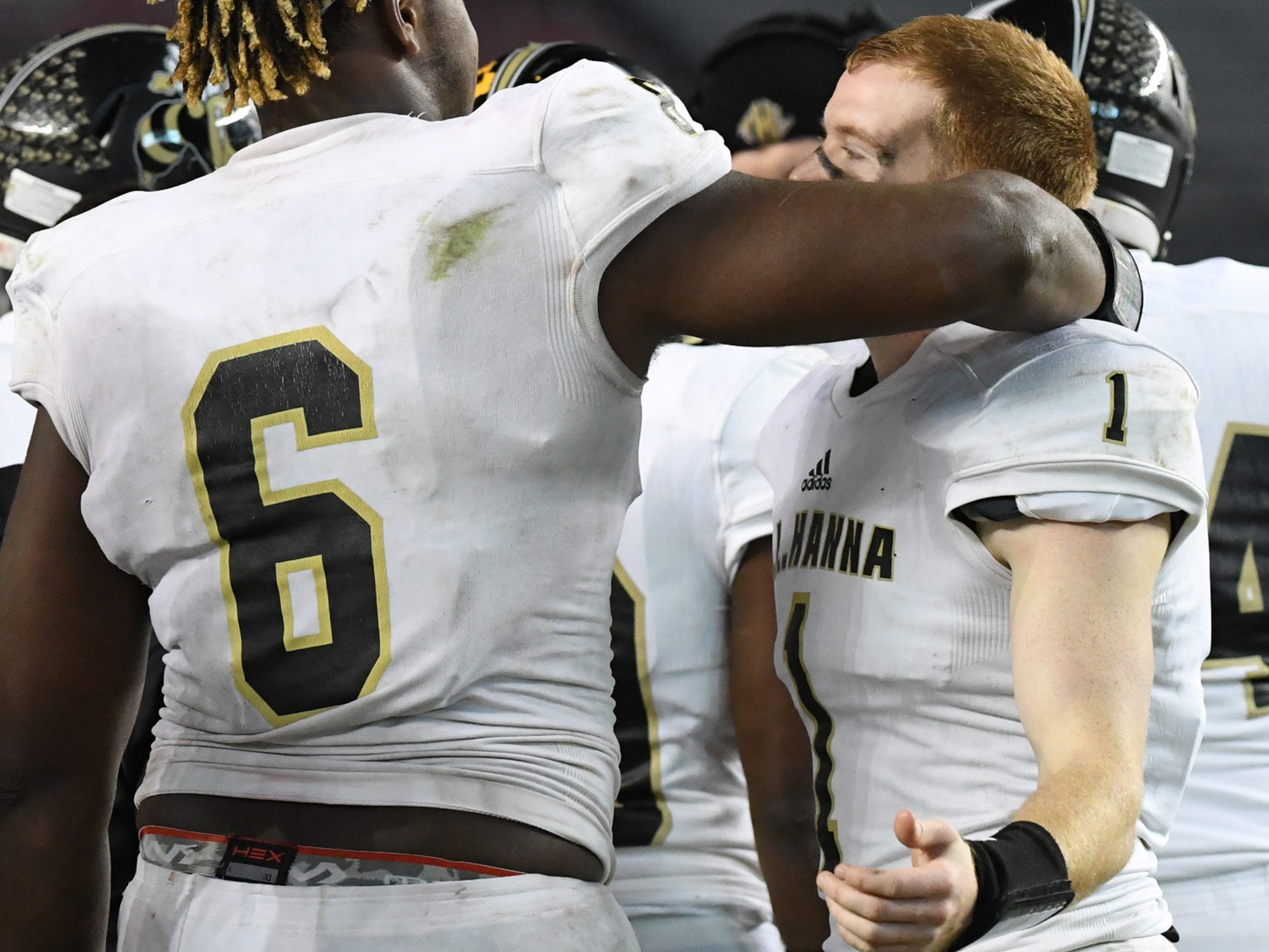 TL Hanna senior Zacch Pickens (6) hugs TL Hanna senior Alex Meredith (1) after the game of the Class AAAAA state championship game at Williams-Brice Stadium in Columbia Saturday, December 8, 2018.