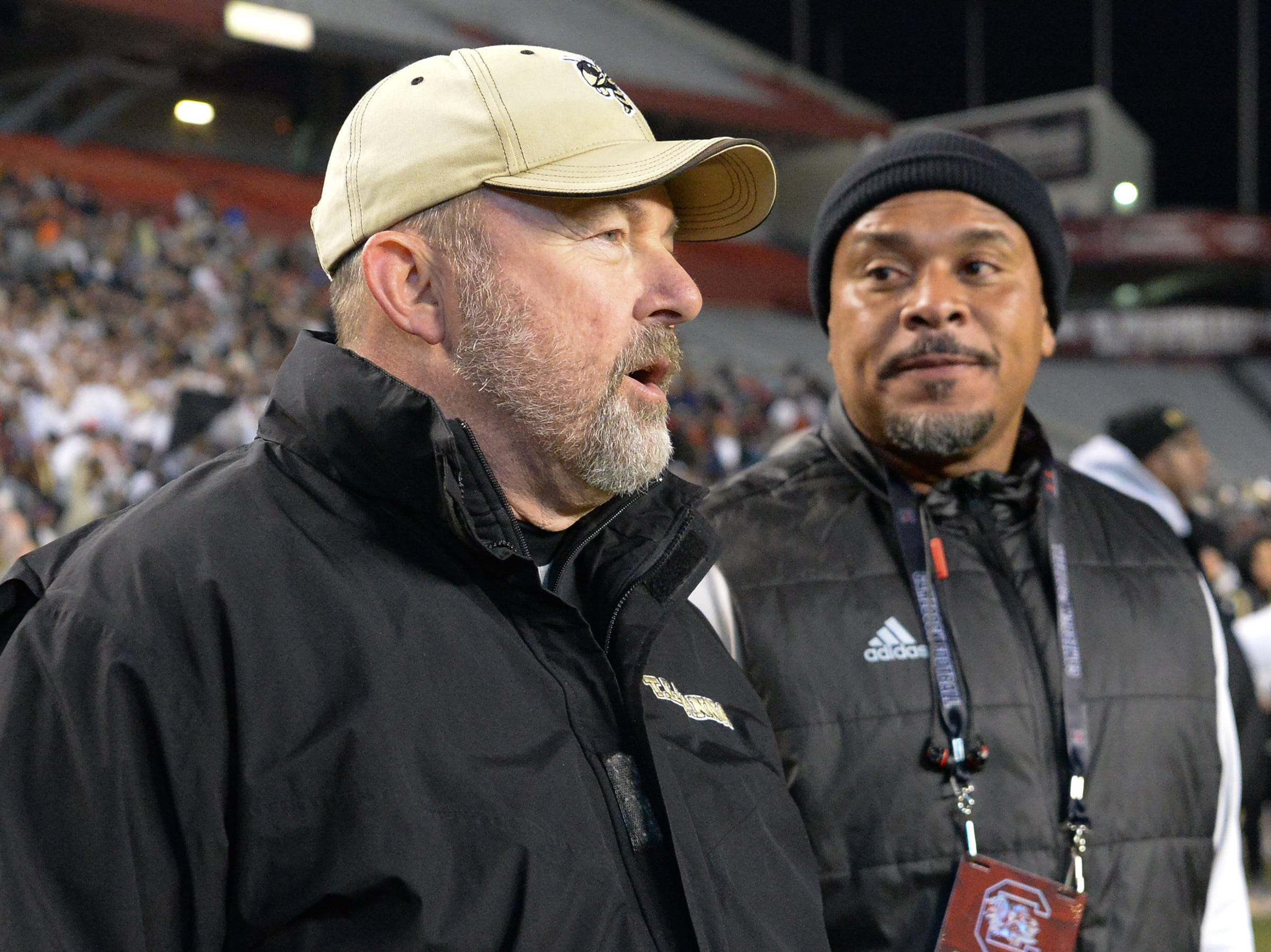 TL Hanna High School Athletic Director John Cann and Ramon Robinson, former Hanna quarterback, during the first quarter of the Class AAAAA state championship game at Williams-Brice Stadium in Columbia Saturday, December 8, 2018.