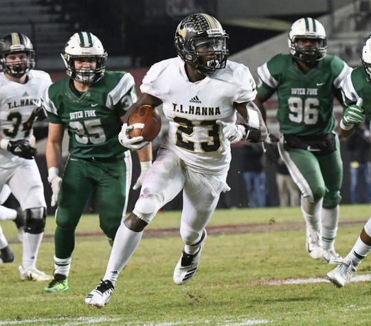 TL Hanna senior Isaiah Norris (23) runs near Dutch Fork senior Jamar Walker(96) during the second quarter of the Class AAAAA state championship game at Williams-Brice Stadium in Columbia Saturday, December 8, 2018.
