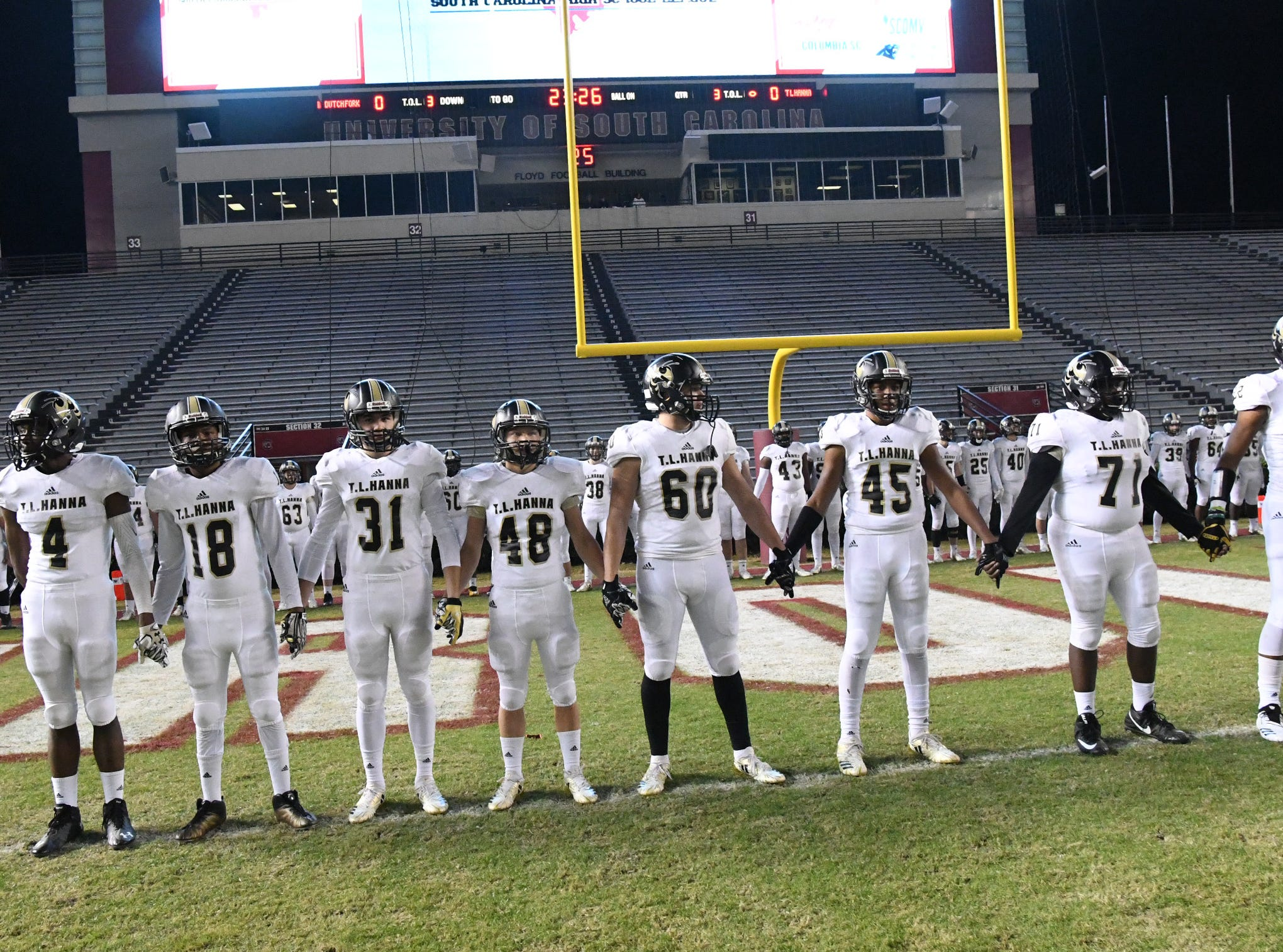 TL Hanna teammates warm up before the kickoff of the Class AAAAA state championship game at Williams-Brice Stadium in Columbia Saturday, December 8, 2018.
