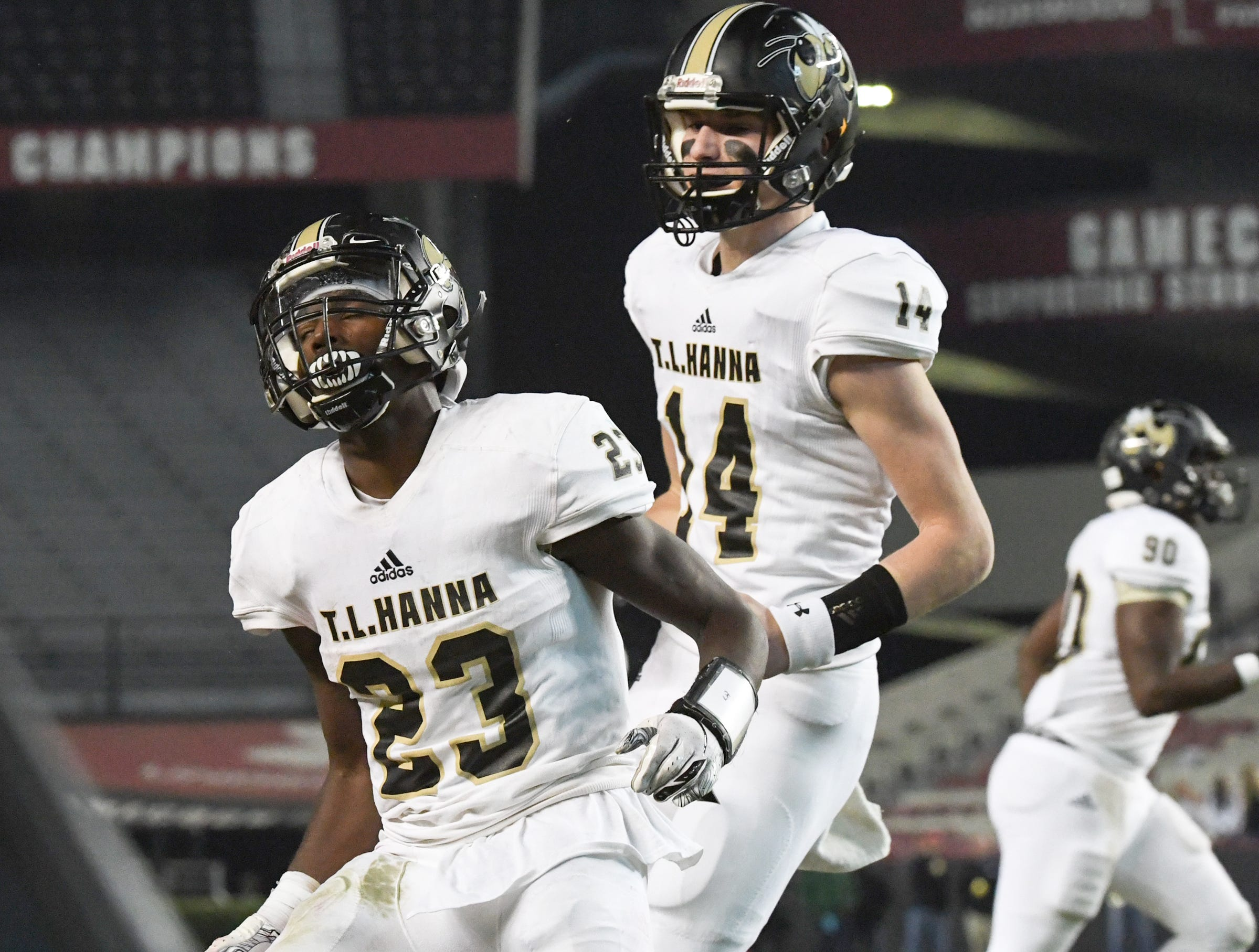 TL Hanna senior Isaiah Norris (23) celebrates an eight-yard touchdown against Dutch Fork during the second quarter of the Class AAAAA state championship game at Williams-Brice Stadium in Columbia Saturday, December 8, 2018.