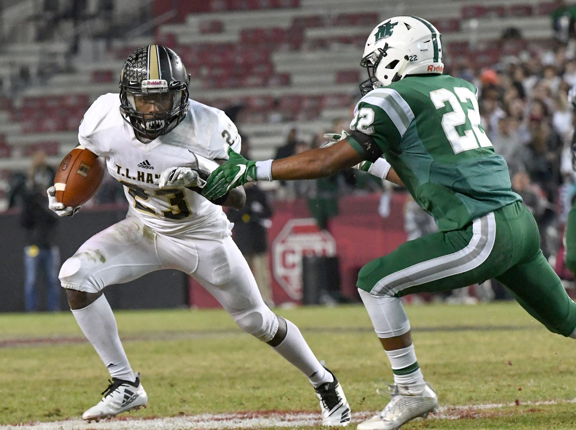TL Hanna senior Isaiah Norris (23) runs near Dutch Fork senior Ryan Harris(22) during the second quarter of the Class AAAAA state championship game at Williams-Brice Stadium in Columbia Saturday, December 8, 2018.