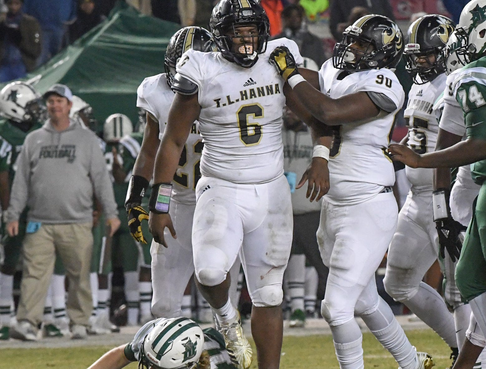 TL Hanna sophomore Ryan Wynn (90) congratulates TL Hanna senior Zacch Pickens (6) for sacking Dutch Fork junior Tyler Olenchuk(10) during the third quarter of the Class AAAAA state championship game at Williams-Brice Stadium in Columbia Saturday, December 8, 2018.