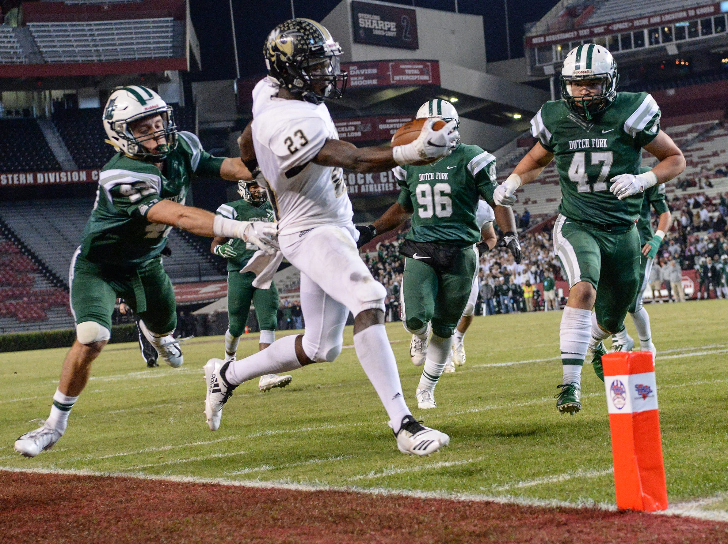 TL Hanna senior Isaiah Norris (23) nearly scores near Dutch Fork senior Lawson Danley(47) during the second quarter of the Class AAAAA state championship game at Williams-Brice Stadium in Columbia Saturday, December 8, 2018.