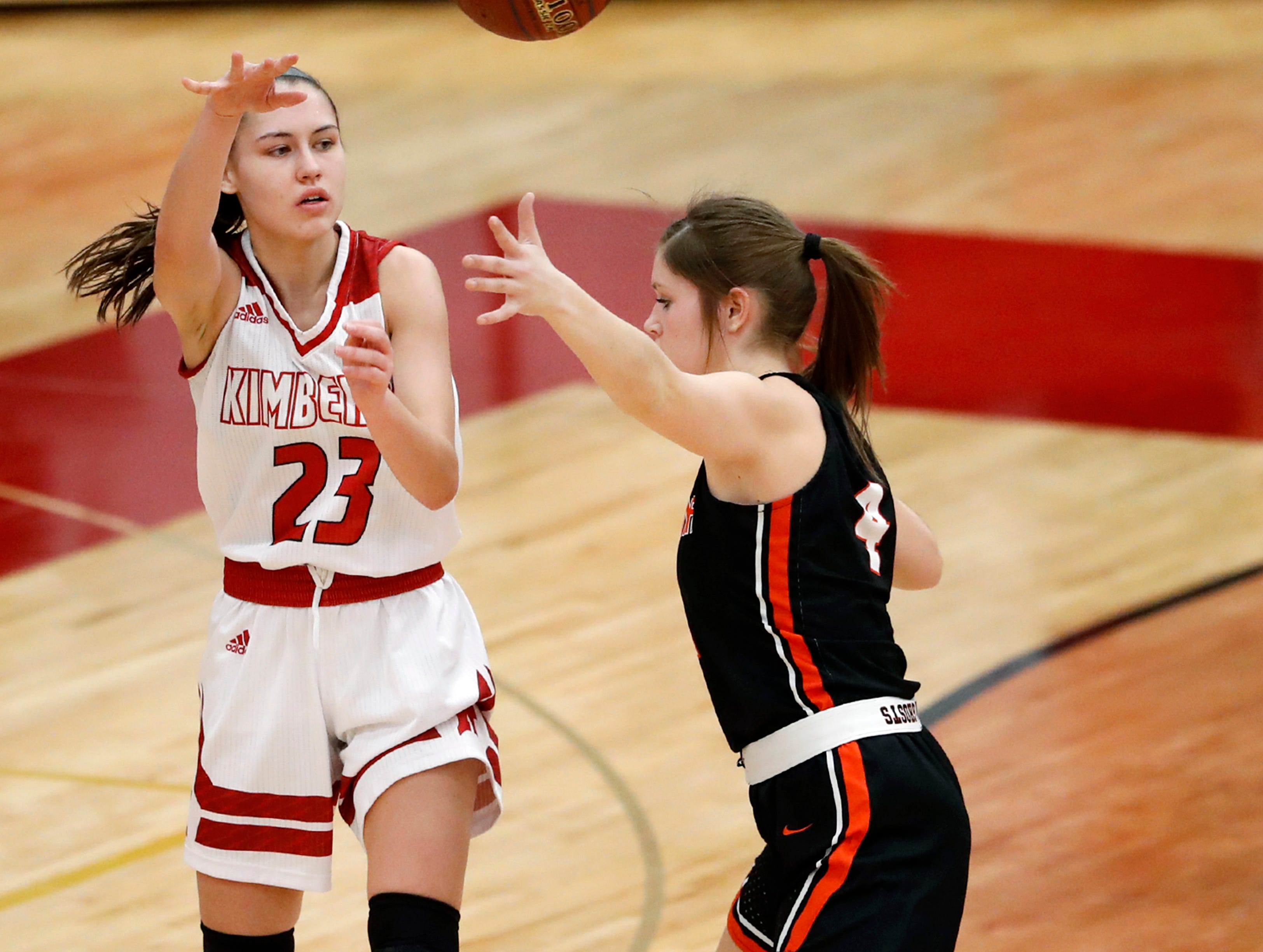 Kimberly High School's Bryn Sikora looks for a pass during their game against Kaukauna High School Friday, Dec. 7, 2018, in Kimberly, Wis.