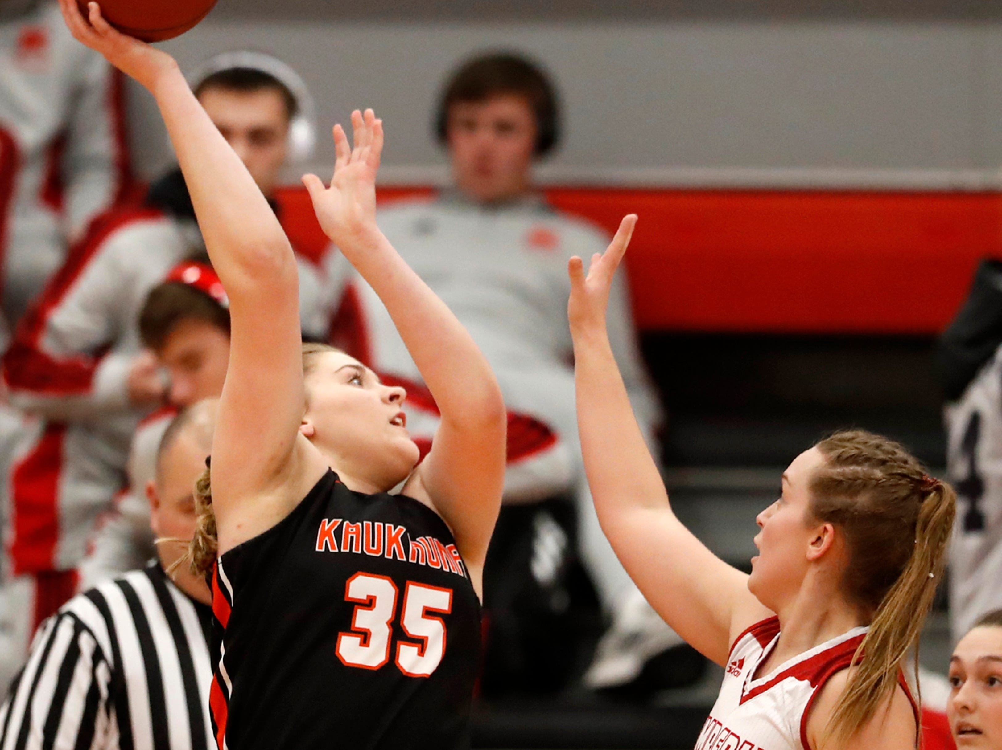 Kaukauna High School's Madison Herdina tries to get a shot off against Kimberly High School Friday, Dec. 7, 2018, in Kimberly, Wis.