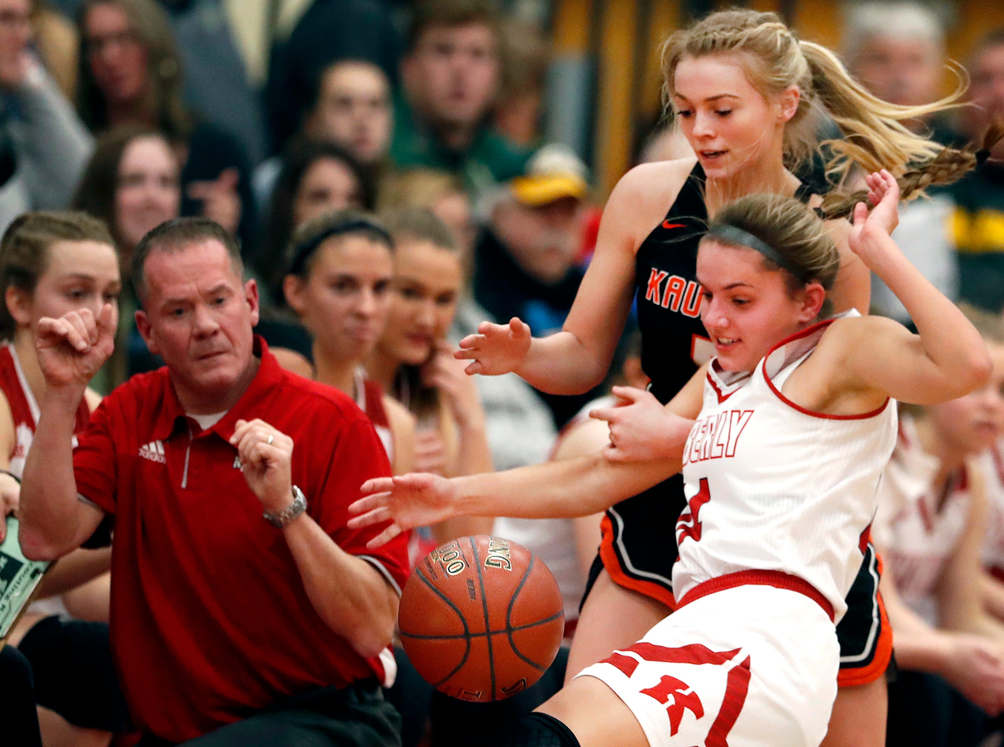 Kimberly High School's Taylor Hietpas drops the ball while being covered by Kaukauna High School's Maddy McCabe Friday, Dec. 7, 2018, in Kimberly, Wis. Kimberly High School defeated Kaukauna High School 70-55.