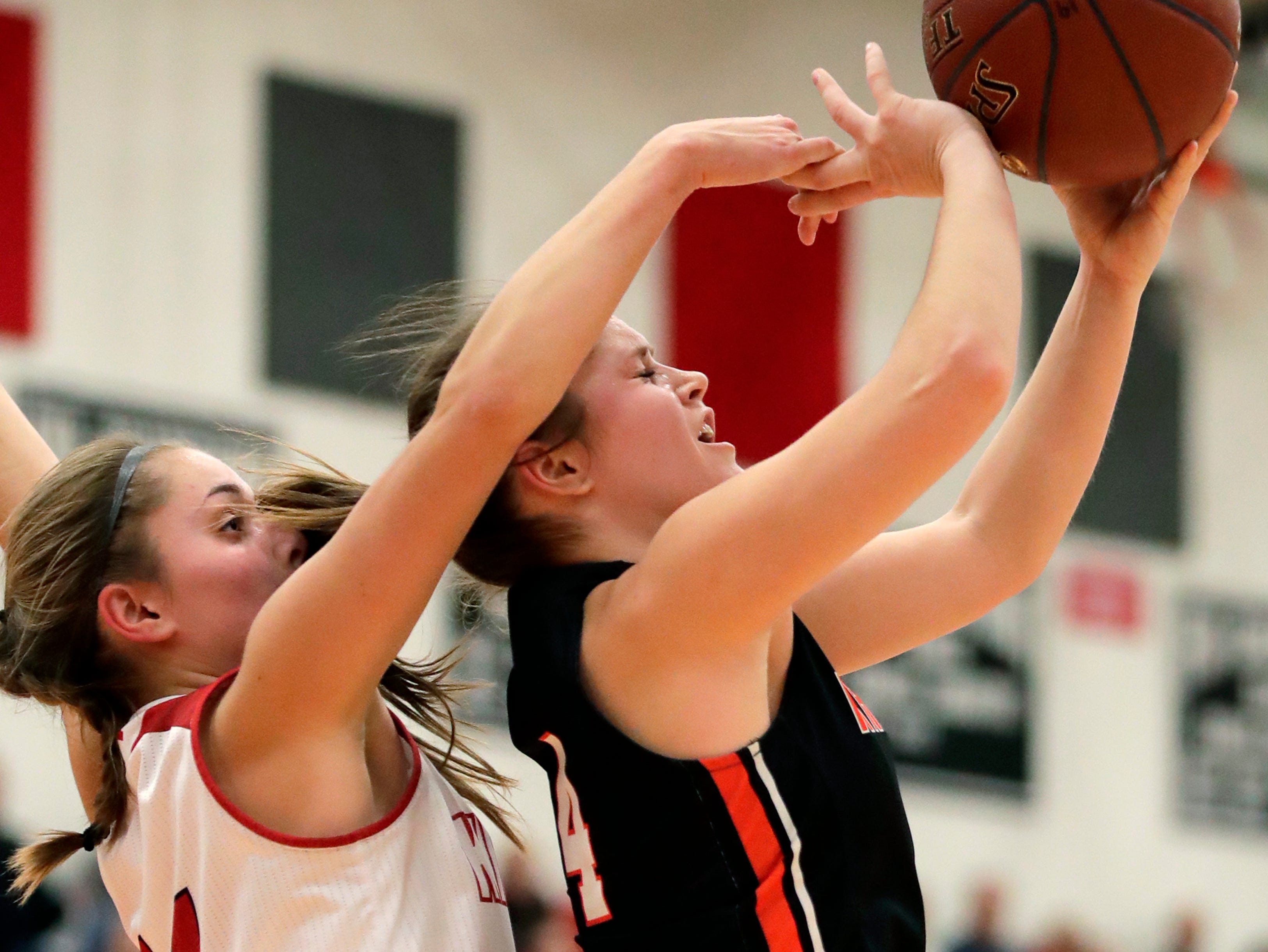 Kimberly High School's Taylor Hietpas tries to cover Kaukauna High School's Graysin Hartjes Friday, Dec. 7, 2018, in Kimberly, Wis.