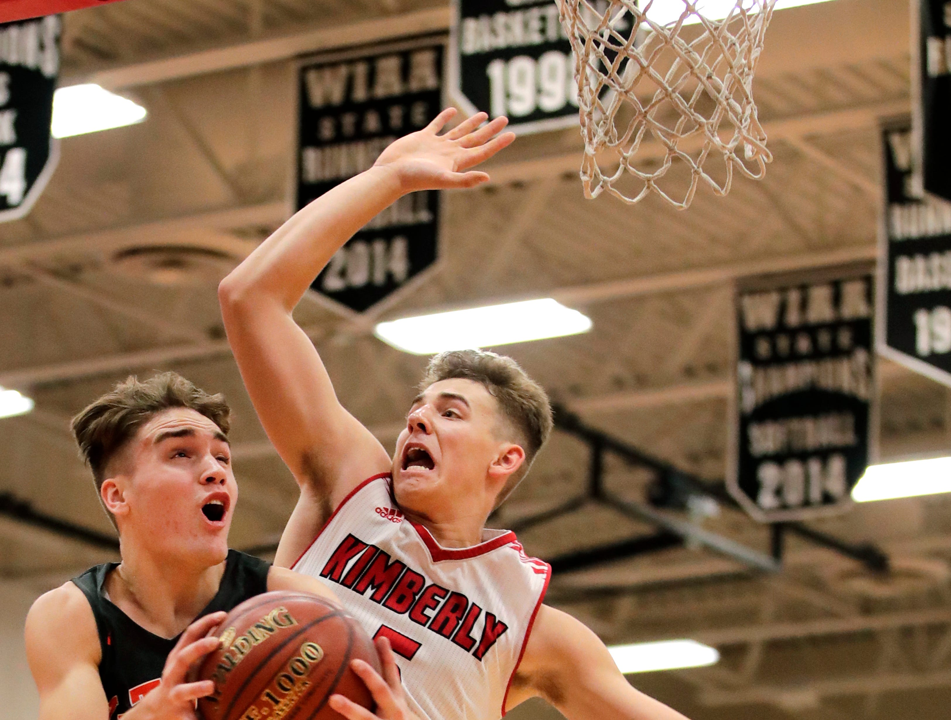 Kaukauna High School's Logan Jedwabny goes for a layup against Kimberly High School's Reed Miller Friday, Dec. 7, 2018, in Kimberly, Wis.