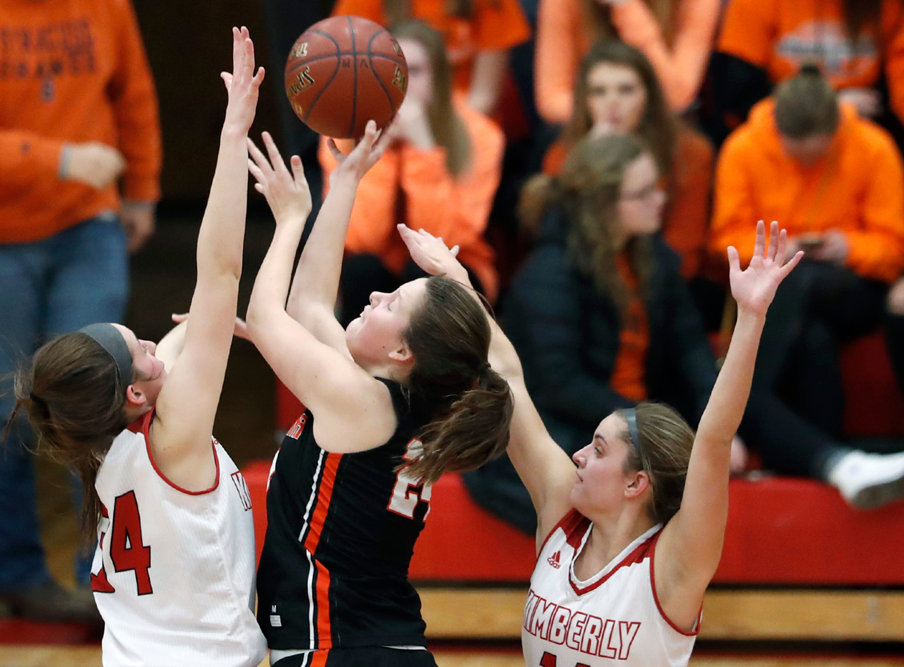 Kimberly High School's Maddy Schreiber and Taylor Hietpas defend against Kaukauna High School's Chloe VanZeeland Friday, Dec. 7, 2018, in Kimberly, Wis.