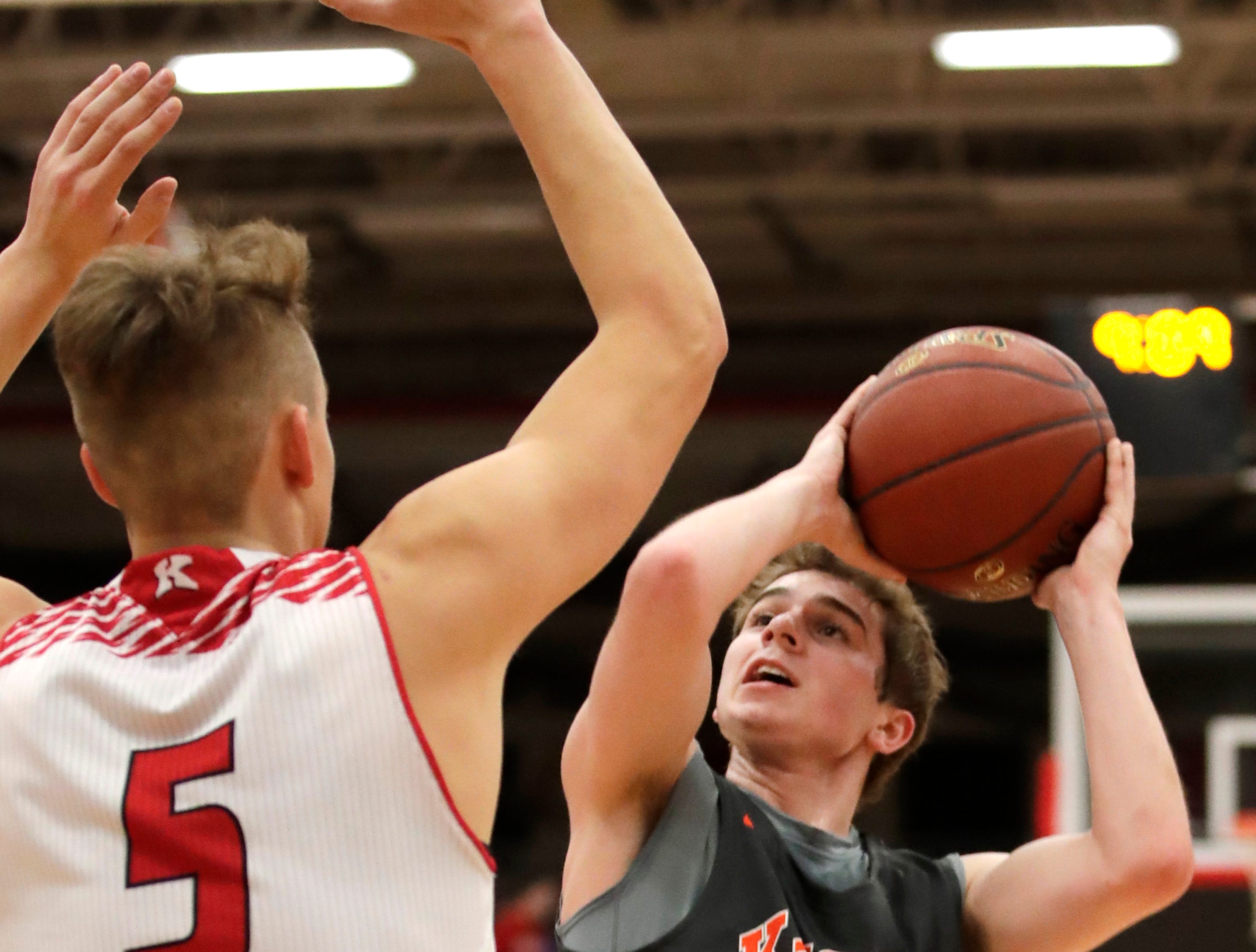 Kaukauna High School's Keaton Ferris looks for a shot against Kimberly High School Friday, Dec. 7, 2018, in Kimberly, Wis.