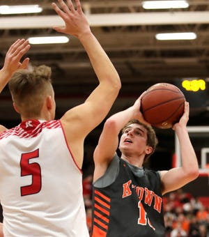 Kaukauna's Keaton Ferris looks for a shot against Kimberly during a game Dec. 7 in Kimberly.