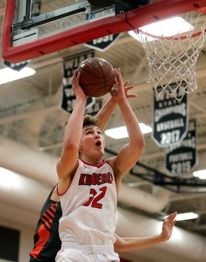 Kimberly's Levi Nienhaus-Borchert goes for a layup against Kaukauna during a game Dec. 7 in Kimberly.