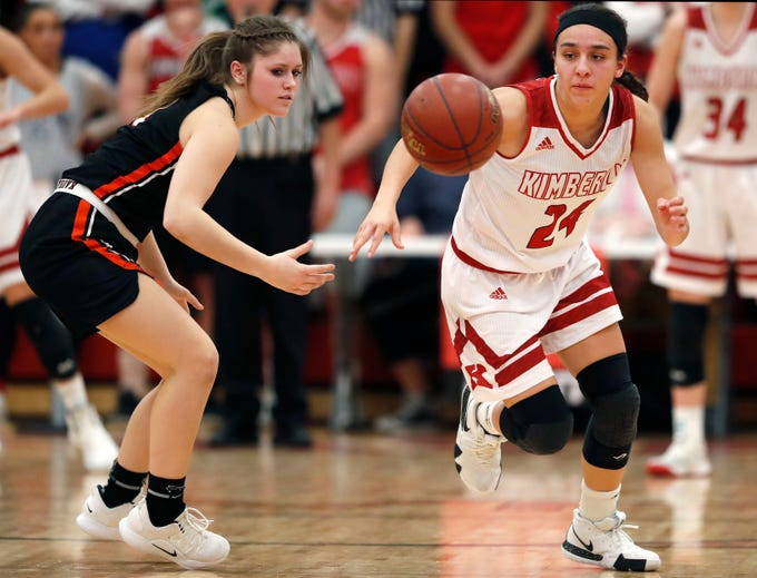 Kimberly High School's Shea Dechant chases after a loose ball during their game against Kaukauna High School Friday, Dec. 7, 2018, in Kimberly, Wis. Kimberly High School defeated Kaukauna High School 70-55.