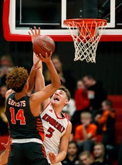 Kaukauna's Brayden Ivory tries to get a shot past Kimberly's Reed Miller on Friday in Kimberly.