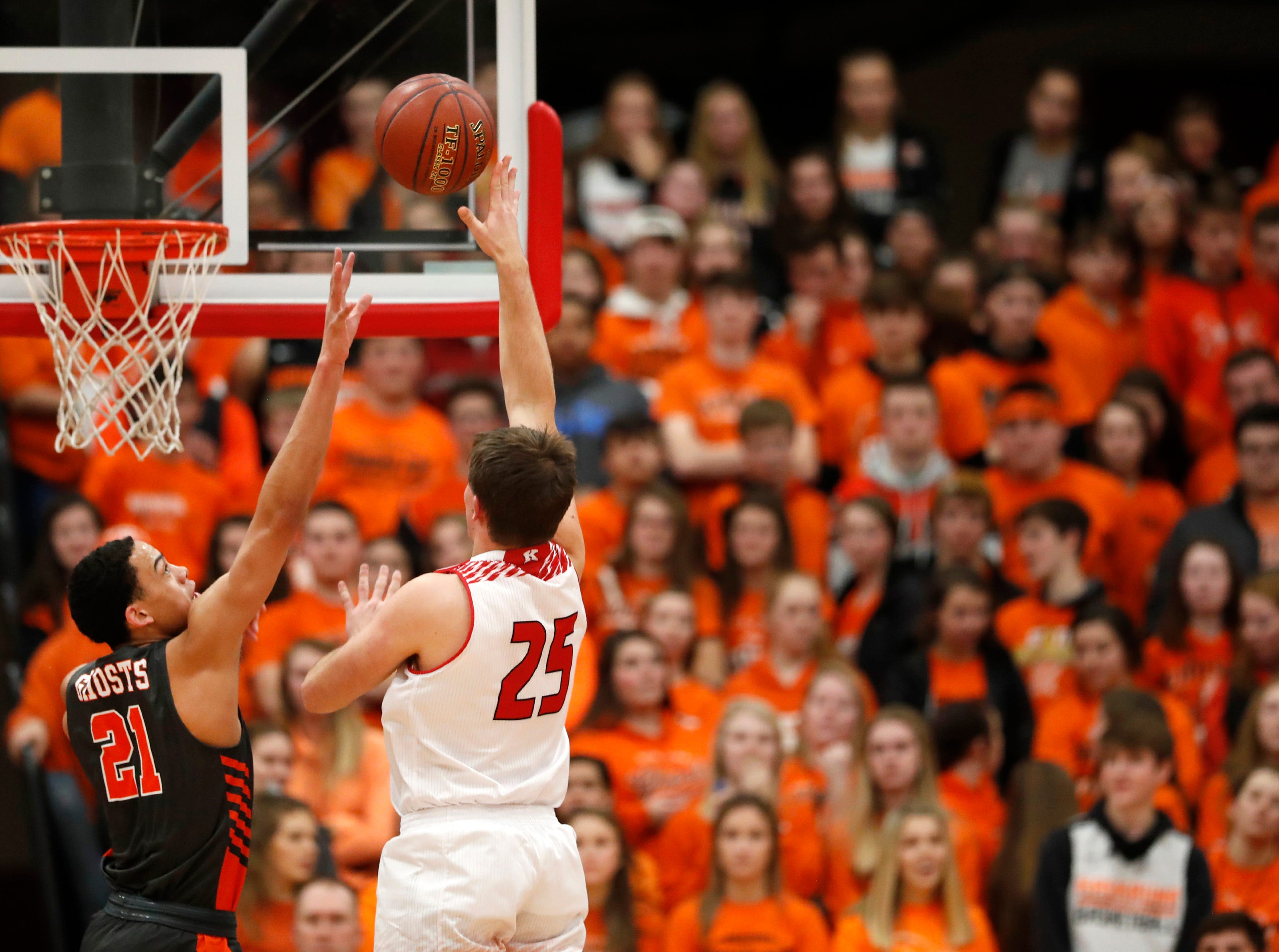Kaukauna High School's Donovan Ivory tries to block a shot from Kimberly High School's Mitch Bartol Friday, Dec. 7, 2018, in Kimberly, Wis.