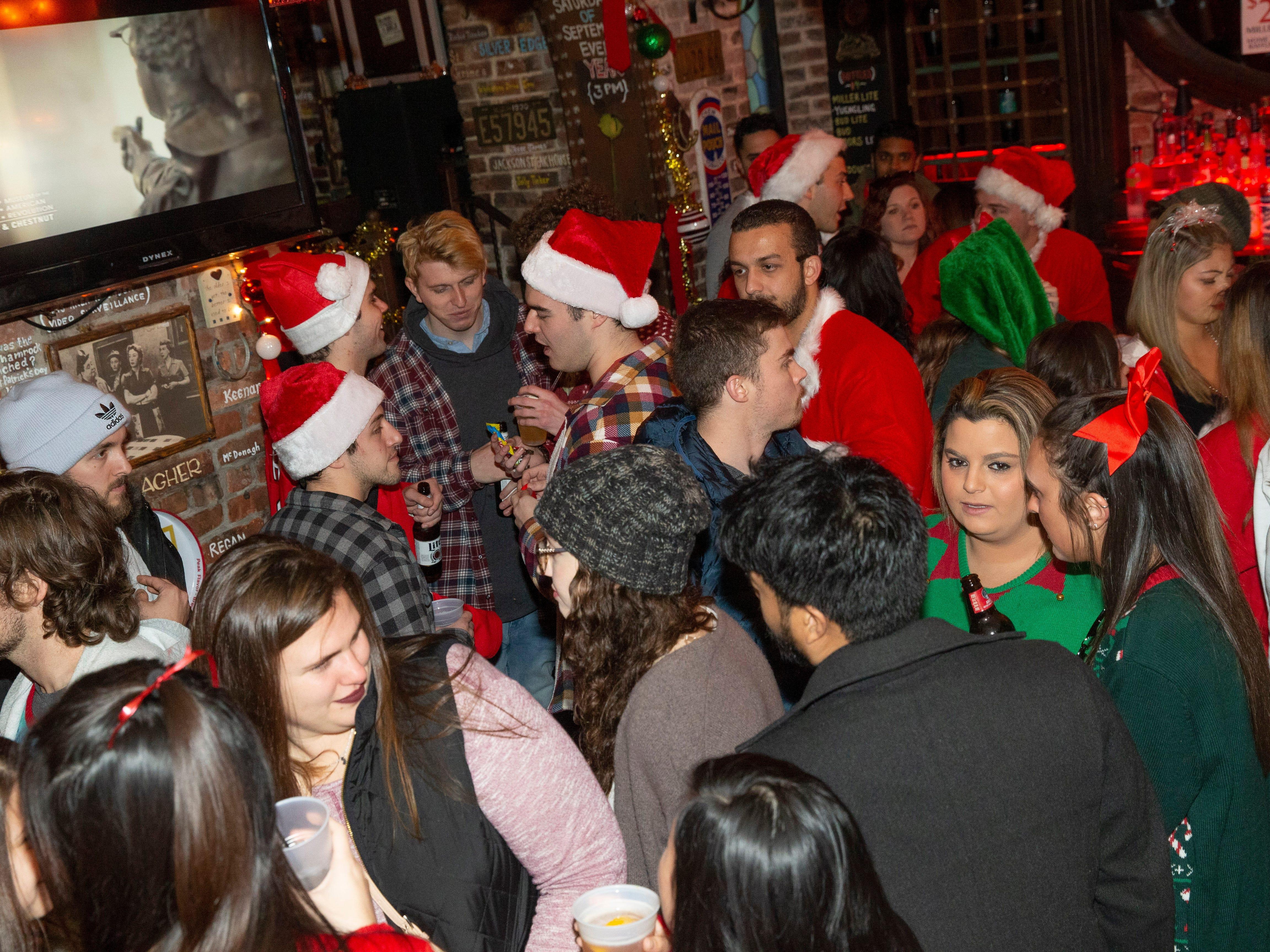 Patrons at Johnny Mac House of Spirits during SantaCon Bar Crawl through Asbury Park on December 8, 2018.