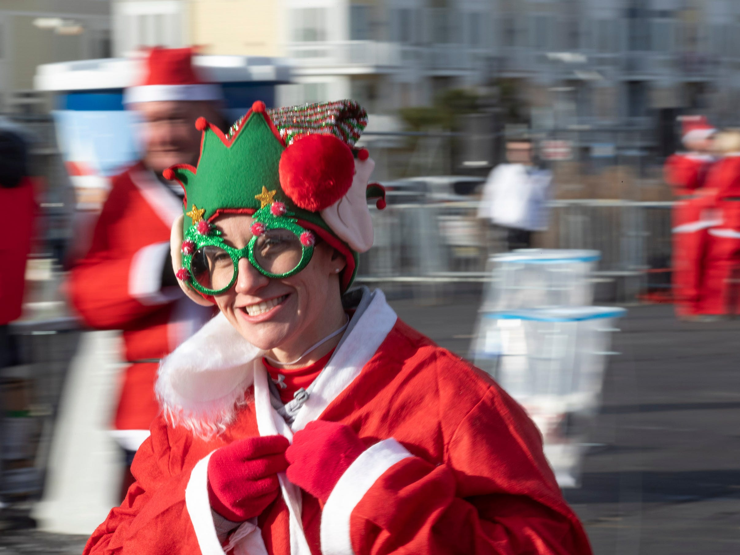 Jen Tanay of Glenside, NJ. heads to the starting line. Runners brave the cold to participate in the annual Santa Run 5K in Asbury Park on December 8, 2018.