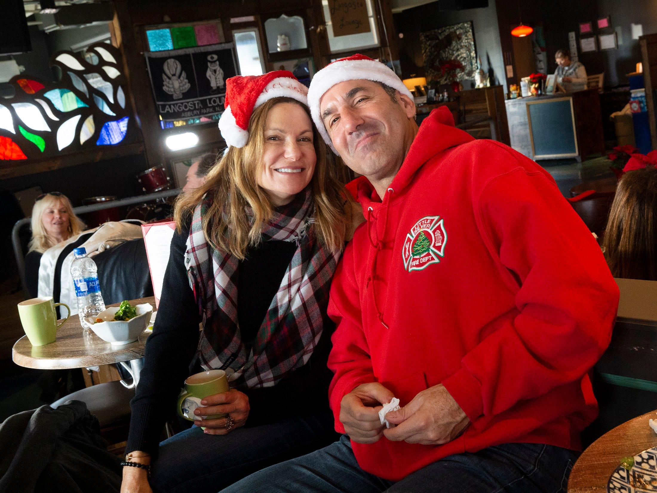 Kimberly Sokol and Brian Paris of Asbury Park enjoy at the Langosta Lounge during SantaCon Crawl through Asbury Park on December 8, 2018.