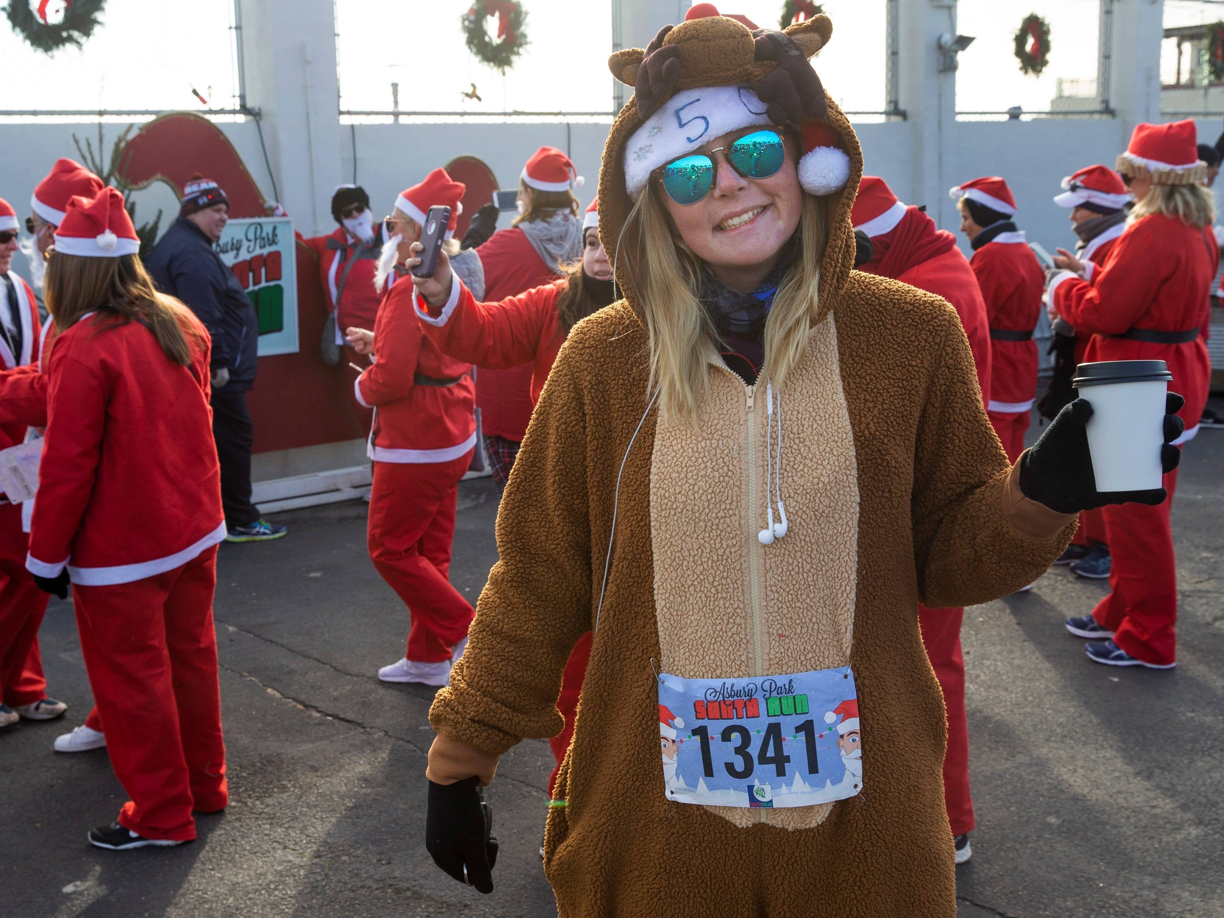 Ceilie Reynolds of Eatontown does the reindeer thing as she participates in run. Runners brave the cold to participate in the annual Santa Run 5K in Asbury Park on December 8, 2018.