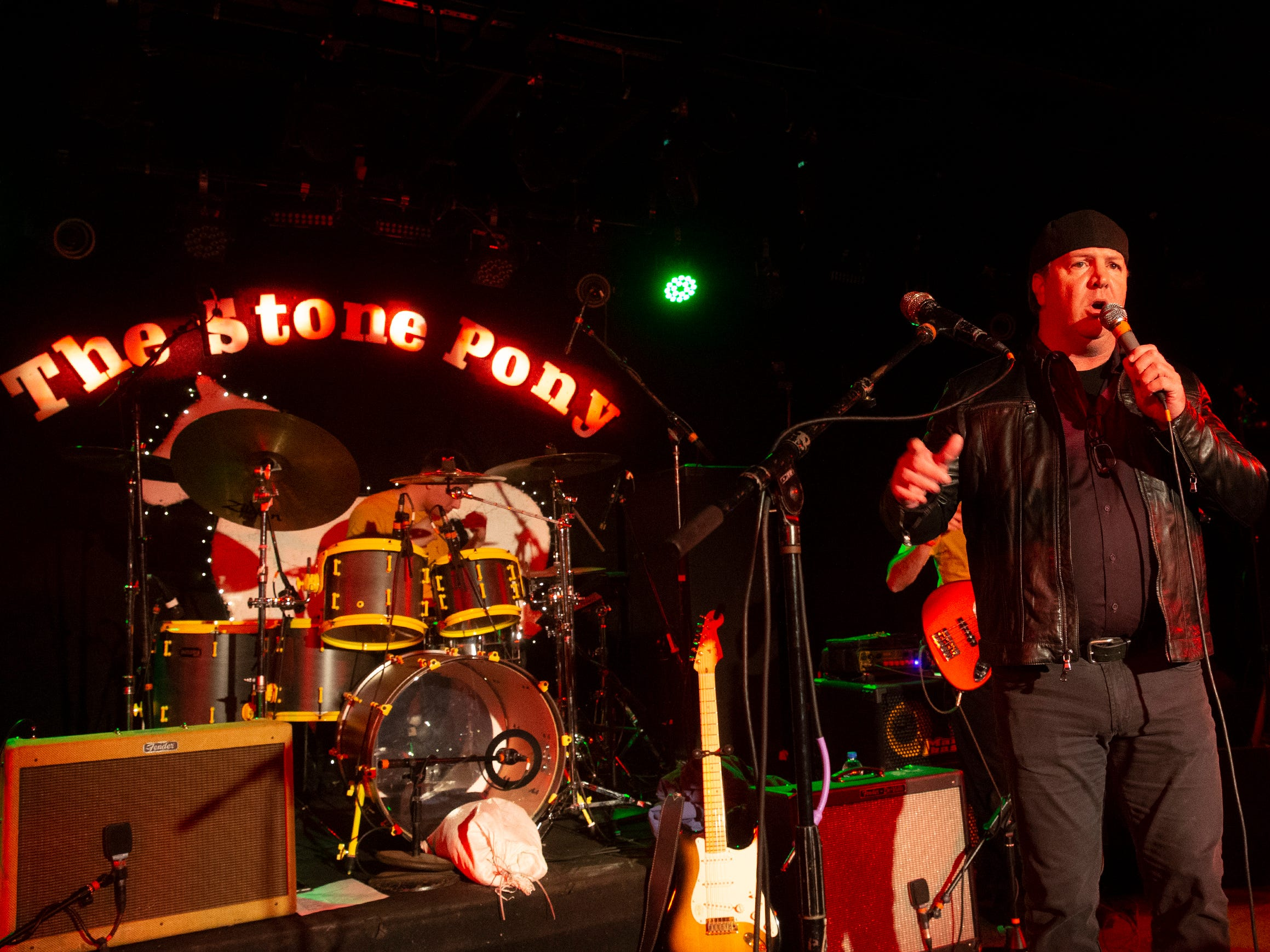 Tom Donovan, publisher of the Asbury Park Press thanks the audience for coming out for show and helping Mary's Place with their contribution as he introduces Quincy Mumford and the Reason Why's tribute to Prince at the Stone Pony in Asbury Park on December 7, 2018.