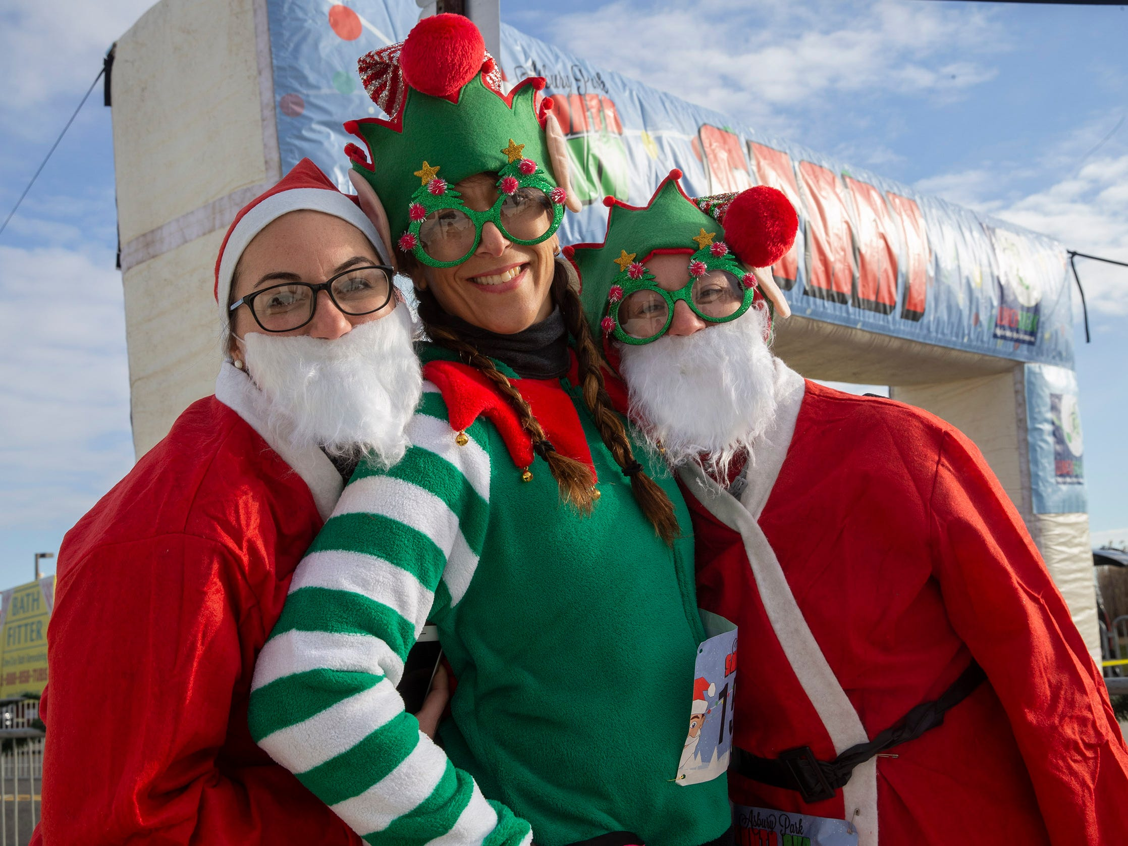 Amailie Kreitman of Glenside, NJ, Jen Tanay of Glenside and Briege McDaniel of Bluebell wait for start of race. Runners brave the cold to participate in the annual Santa Run 5K in Asbury Park on December 8, 2018.
