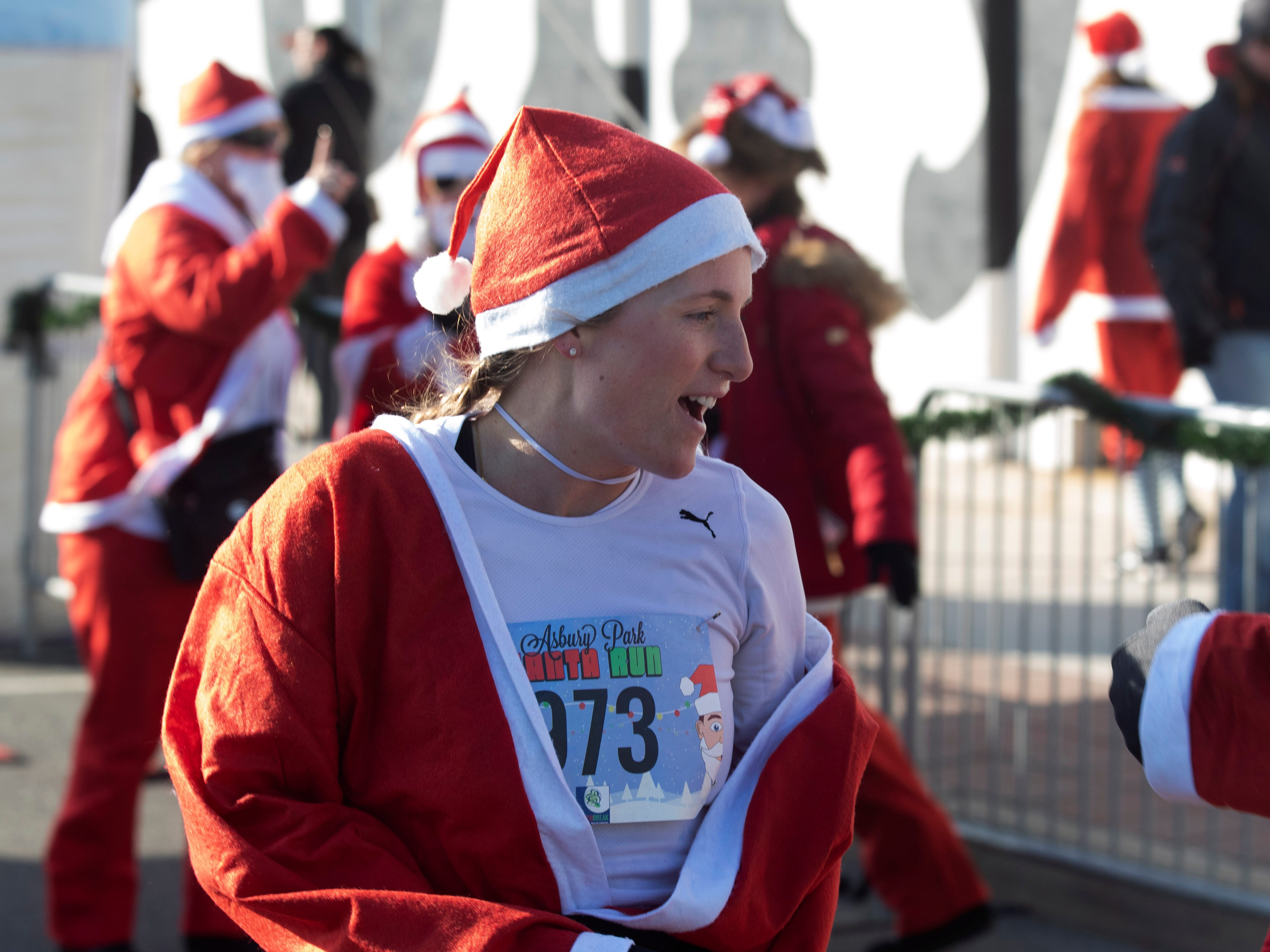 Beth Marzigliano of Lake Como was the women's winner in the 2018 Santa Run. Runners brave the cold to participate in the annual Santa Run 5K in Asbury Park on December 8, 2018.