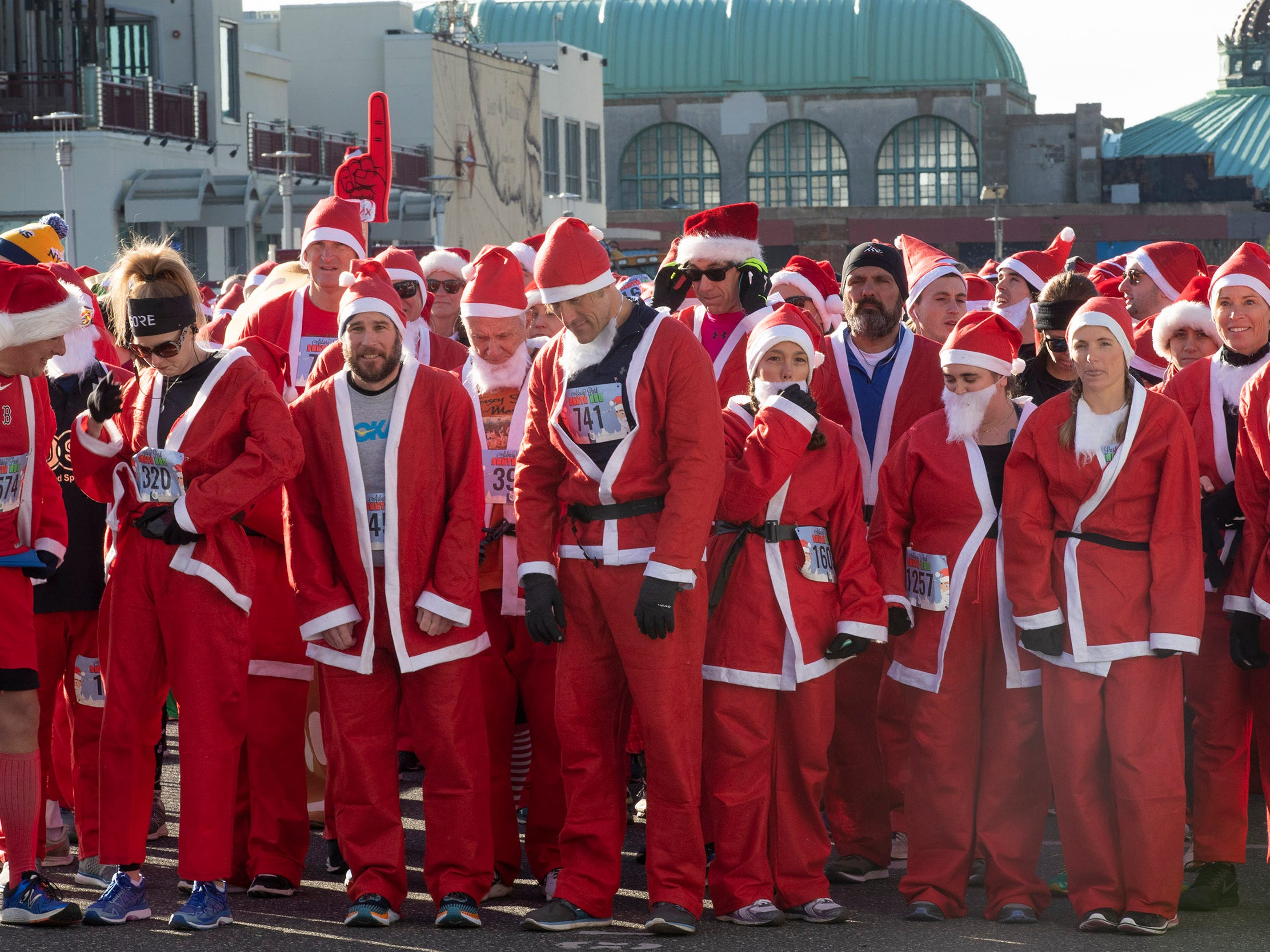 Runers line up for start of the race. Runners brave the cold to participate in the annual Santa Run 5K in Asbury Park on December 8, 2018.