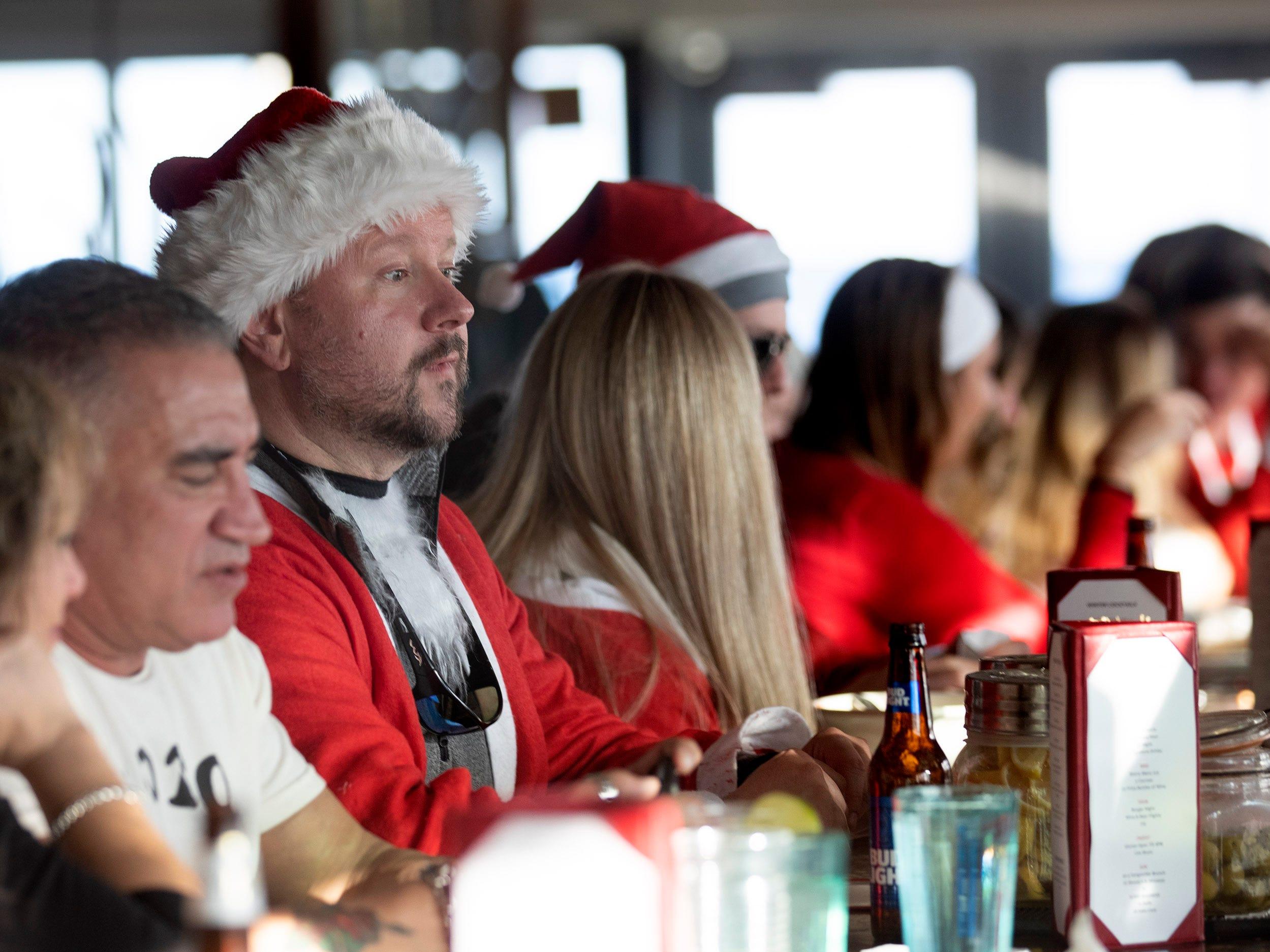 Patrons at the Langosta Lounge during SantaCon Bar Crawl through Asbury Park on December 8, 2018.
