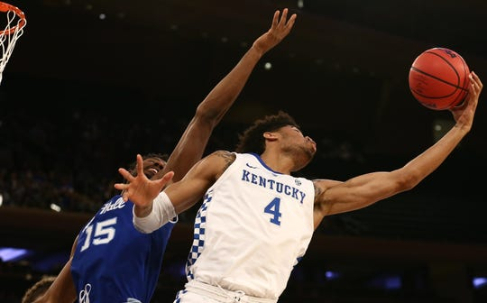 Kentucky Wildcats forward Nick Richards (4) fights for the ball against Seton Hall Pirates forward Taurean Thompson (15)