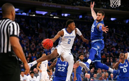 Seton Hall forward Sandro Mamukelashvili (23) defends against Kentucky guard Ashton Hagans (2)