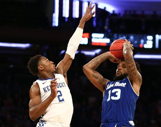 Seton Hall Pirates guard Myles Powell (13) shoots against Kentucky Wildcats forward Ashton Hagans (2)